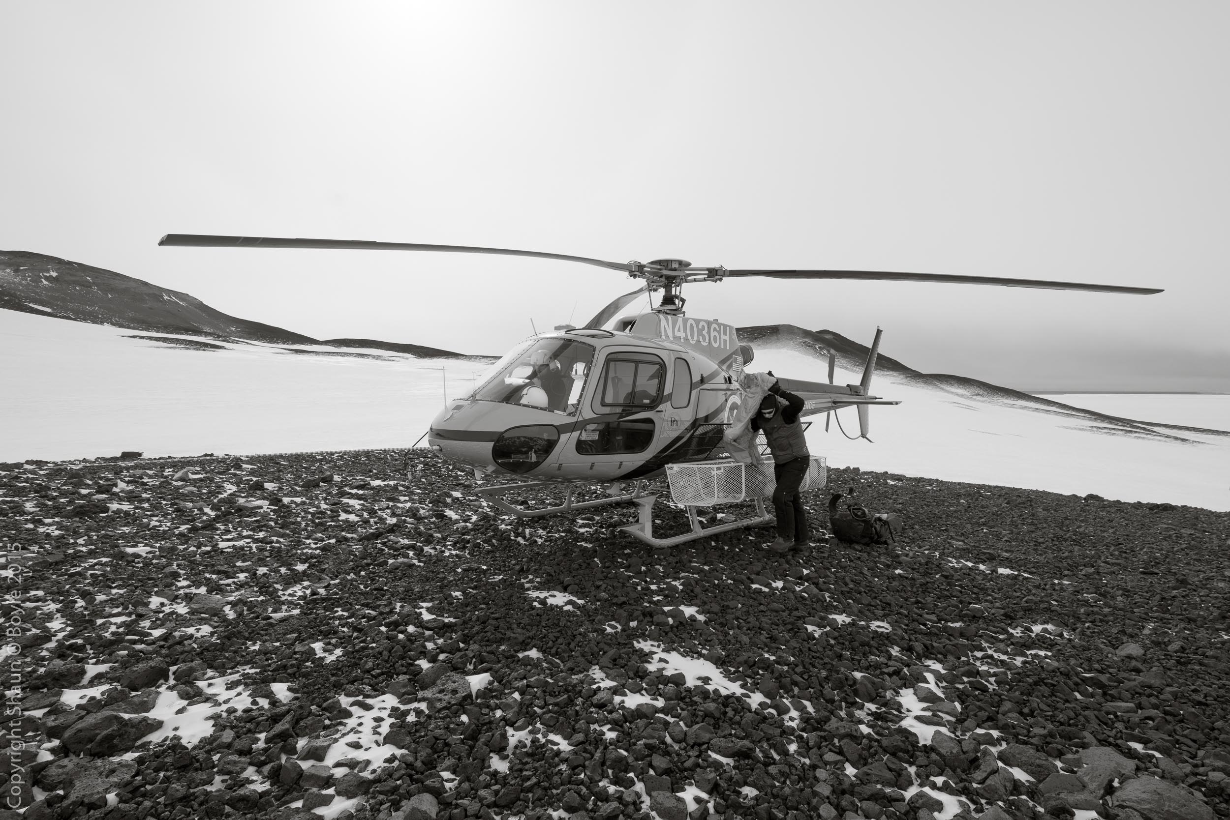 Ted struggling to put on his ECW jacket at the Helo landing site about a half kilometer from Wilson's Igloo