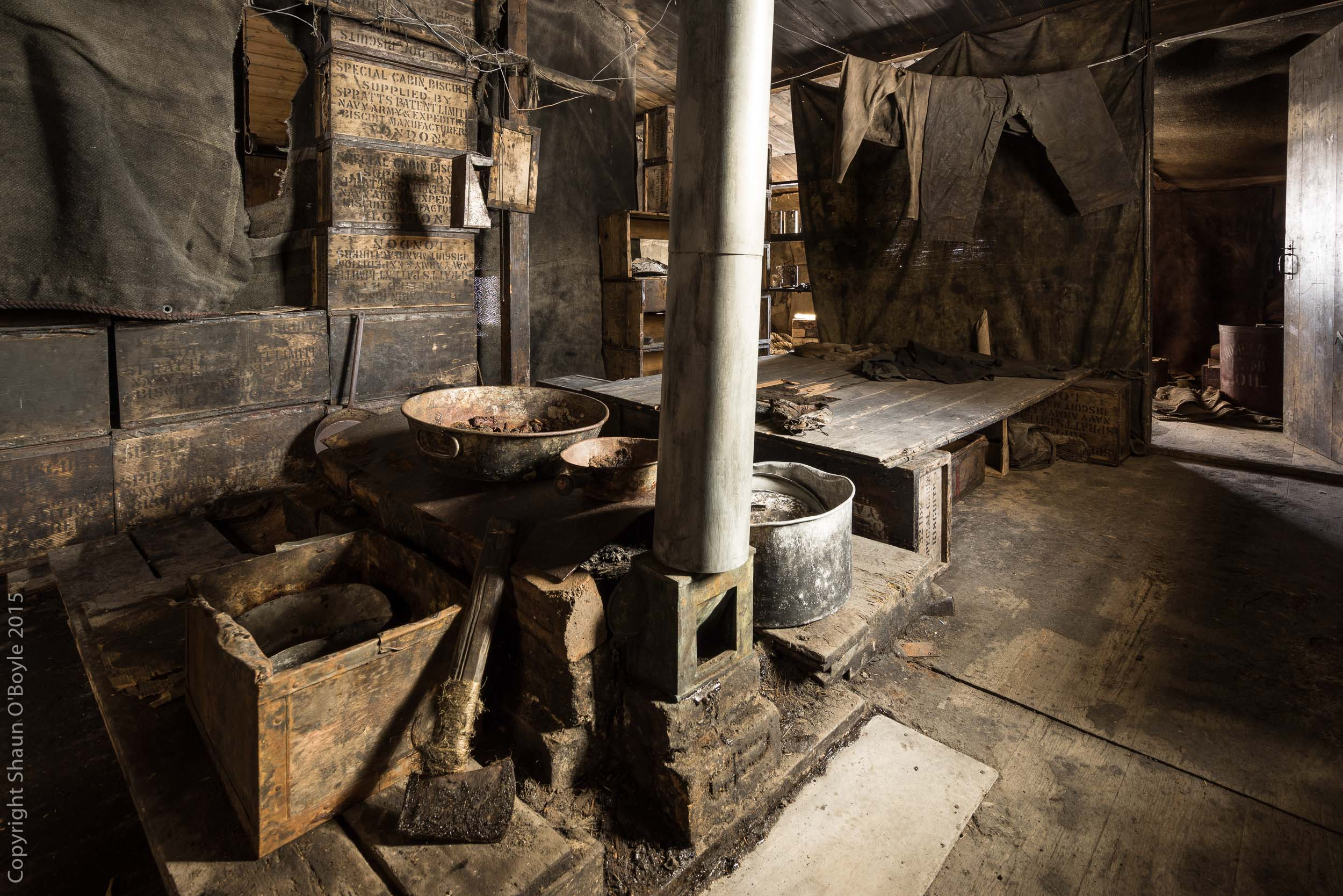 Improvised seal blubber stove and sleep platform. The hut was used extensively during the Terra Nova expedition as a stop off when traveling between Cape Evans and the Barrier and points south.