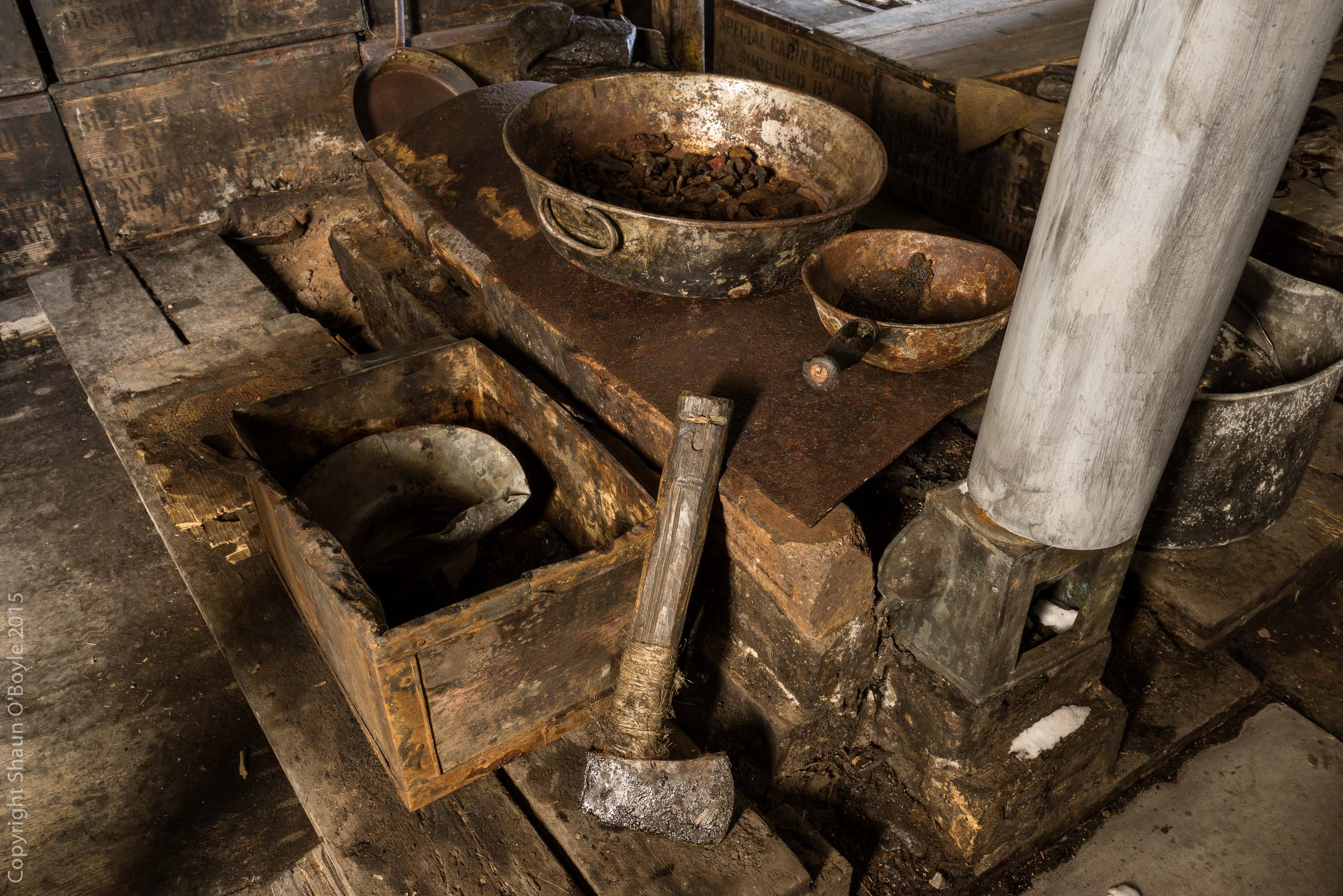 Hatchet used to chop seal blubber to use as fuel in this stove.
