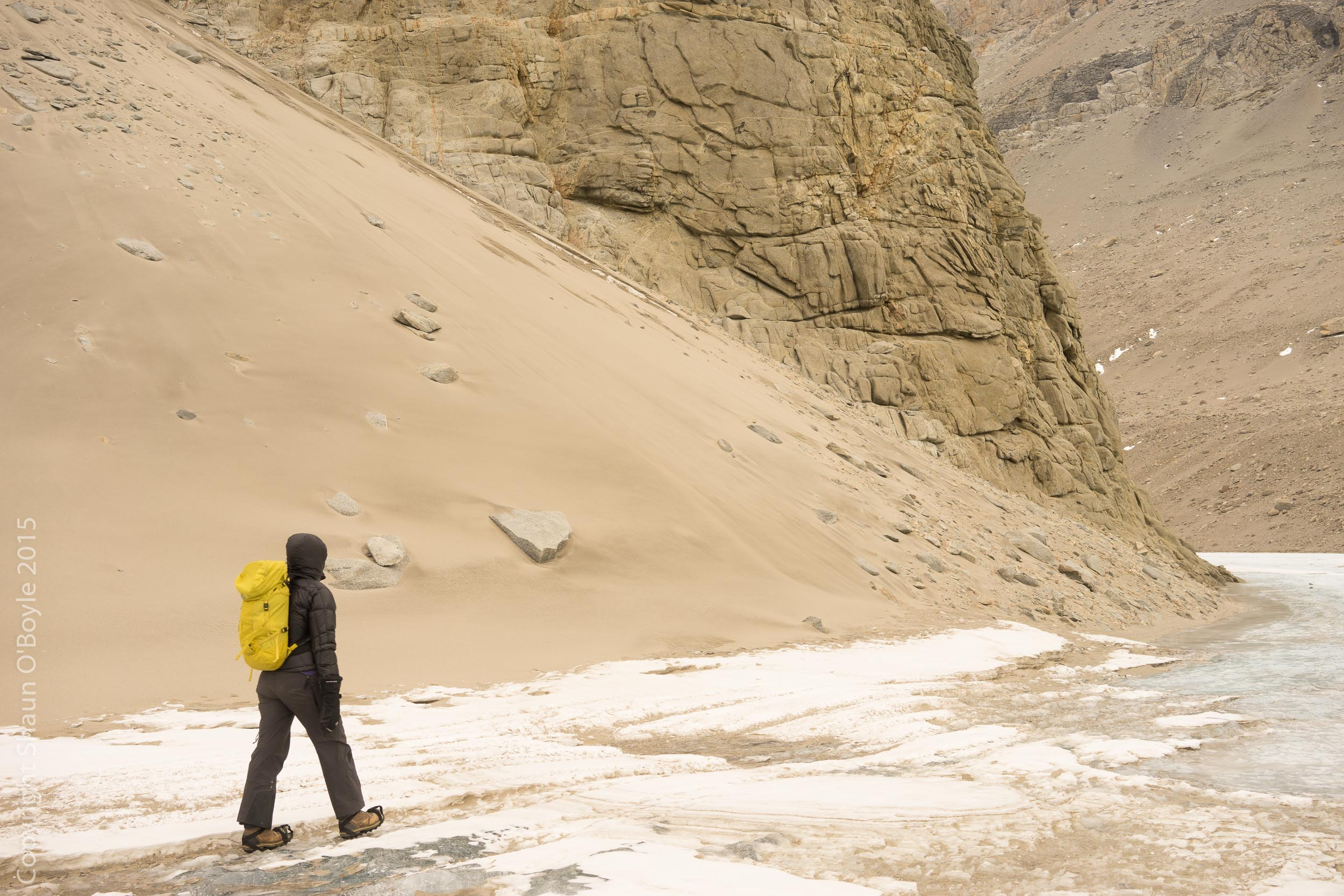 Rene trekking along the slope of Bonney Riegel that seperates the east and west lobes of Lake Bonney