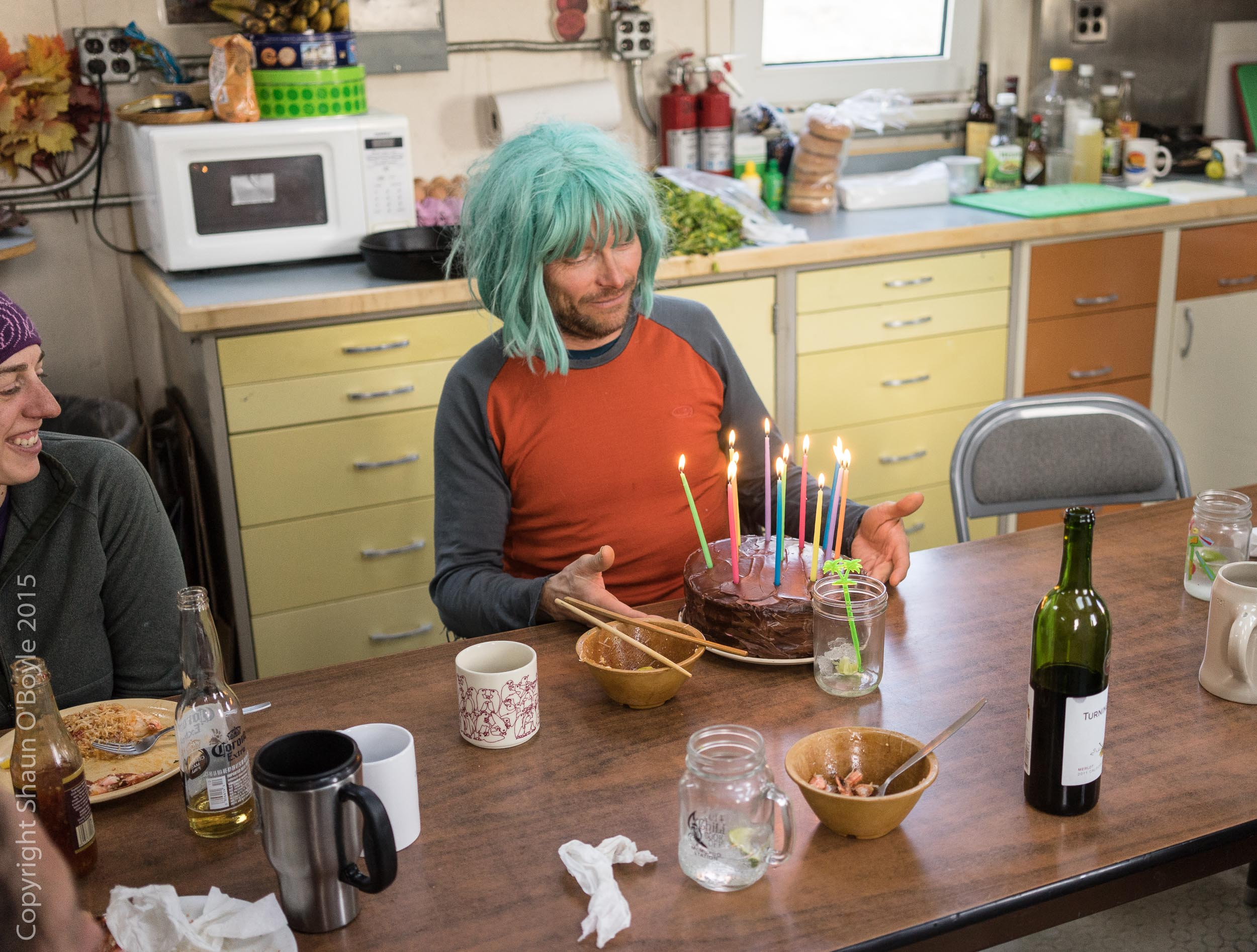 Thomas, wearing the birthday wig, and having a moment with his cake.