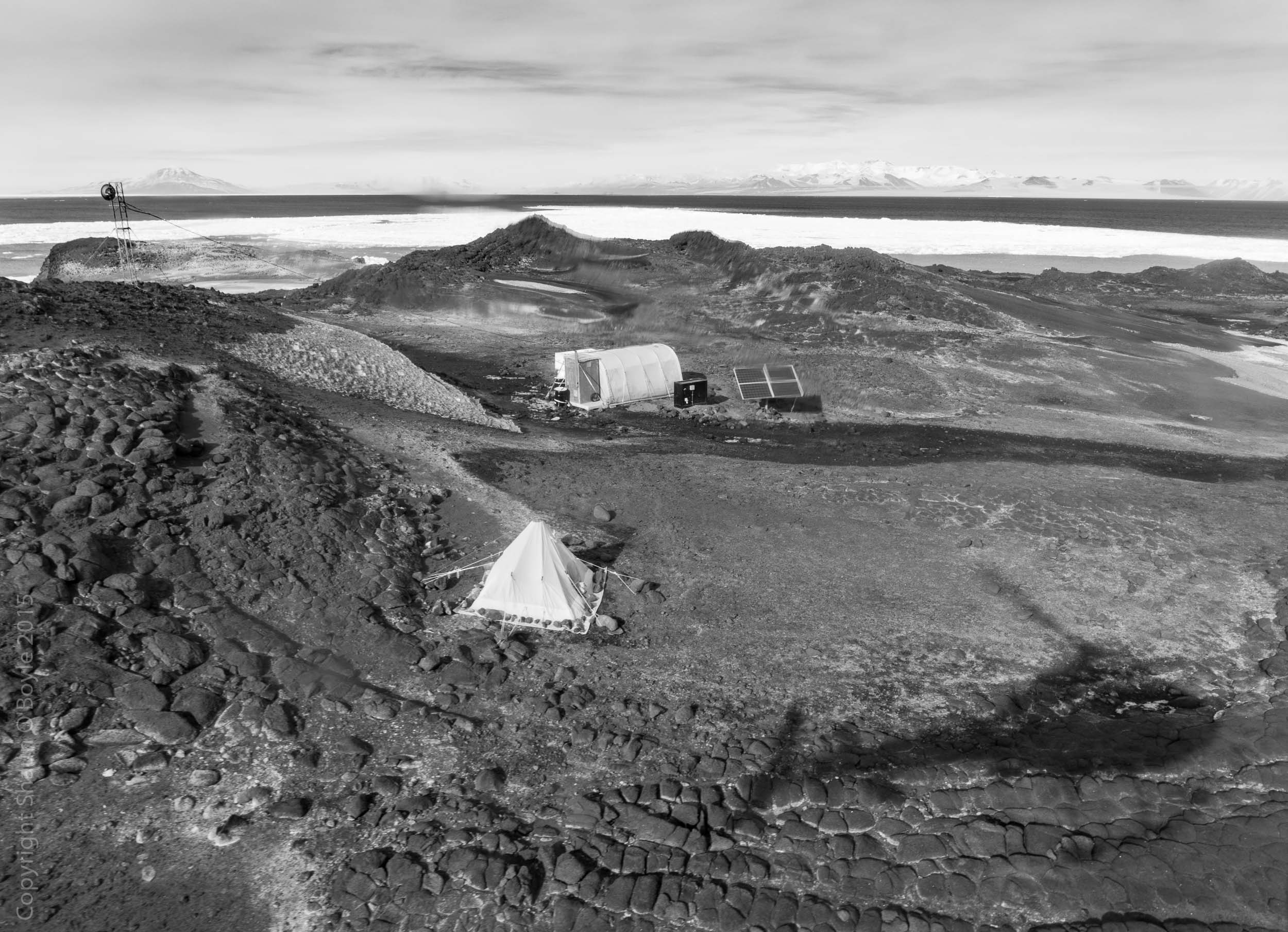 Arriving at Cape Royds Camp. A small setup for two field biologists to study the nearby Adelie Penguin colony. The tent is a Polar Haven tent used as a kitchen and social area.