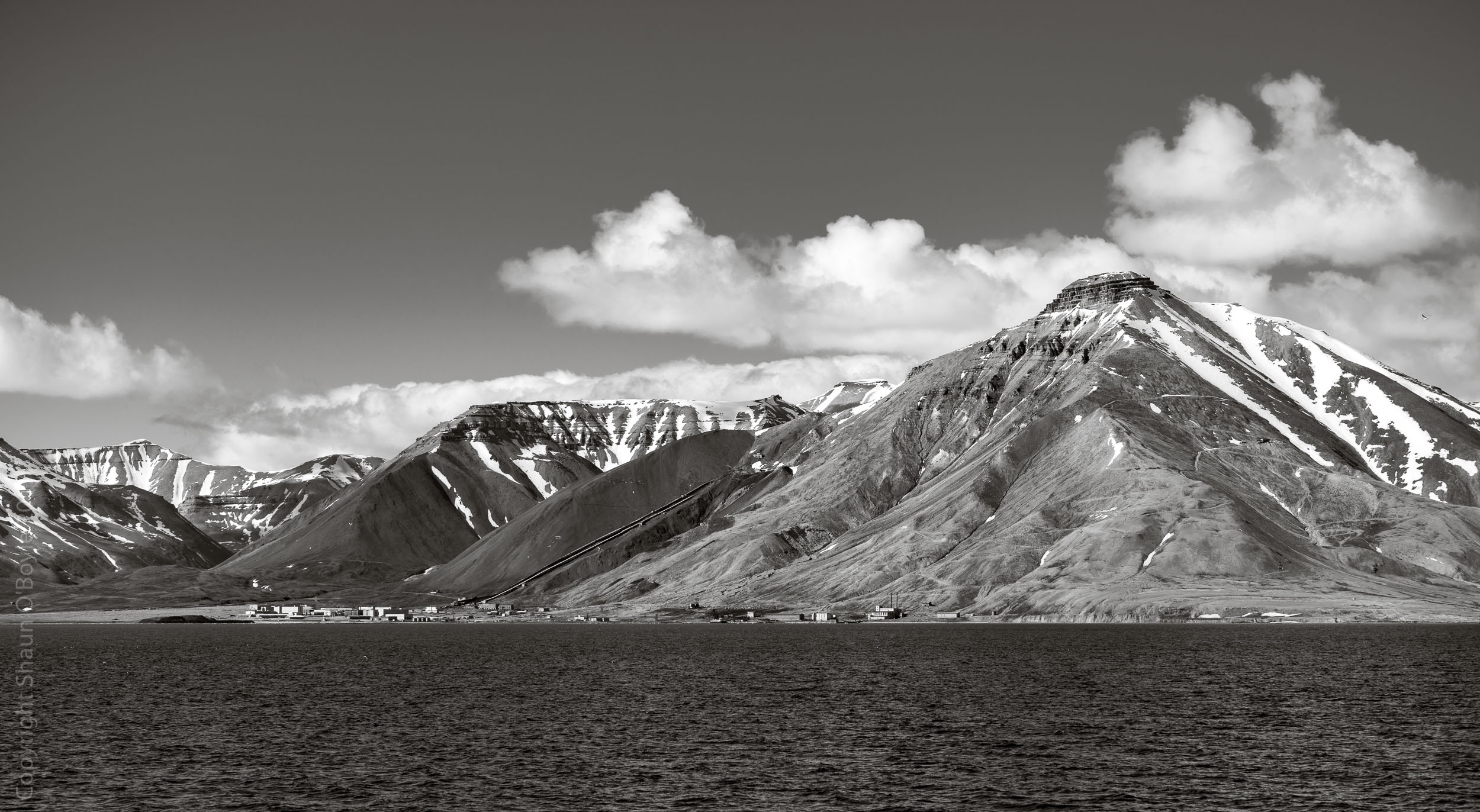 Pyramiden Mountain and the Russian Coal mining settlement of Pyramiden named after the mountain.