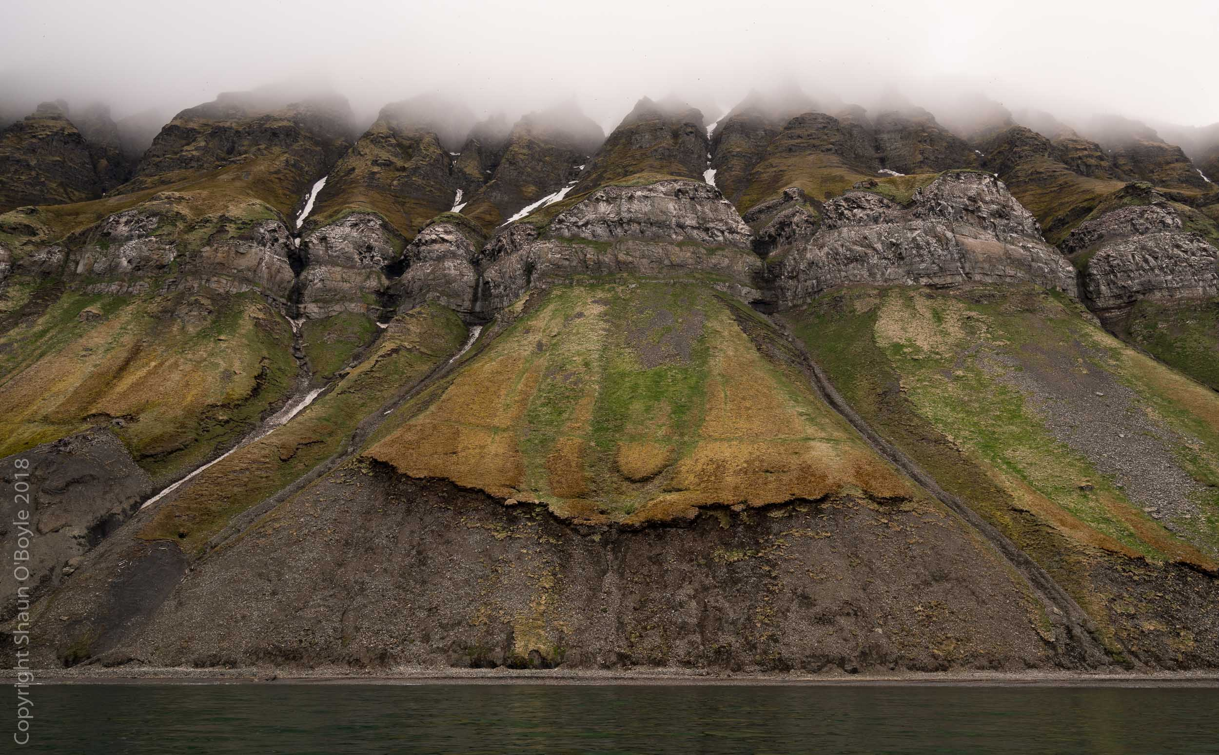 The summer colors of Spitsbergen (with a little help from the thousands of birds that nest here), from a boat trip to see the nesting birds - puffins, guillemots, terns, skua, kittiwakes - on the cliffs of Pilarberget.
