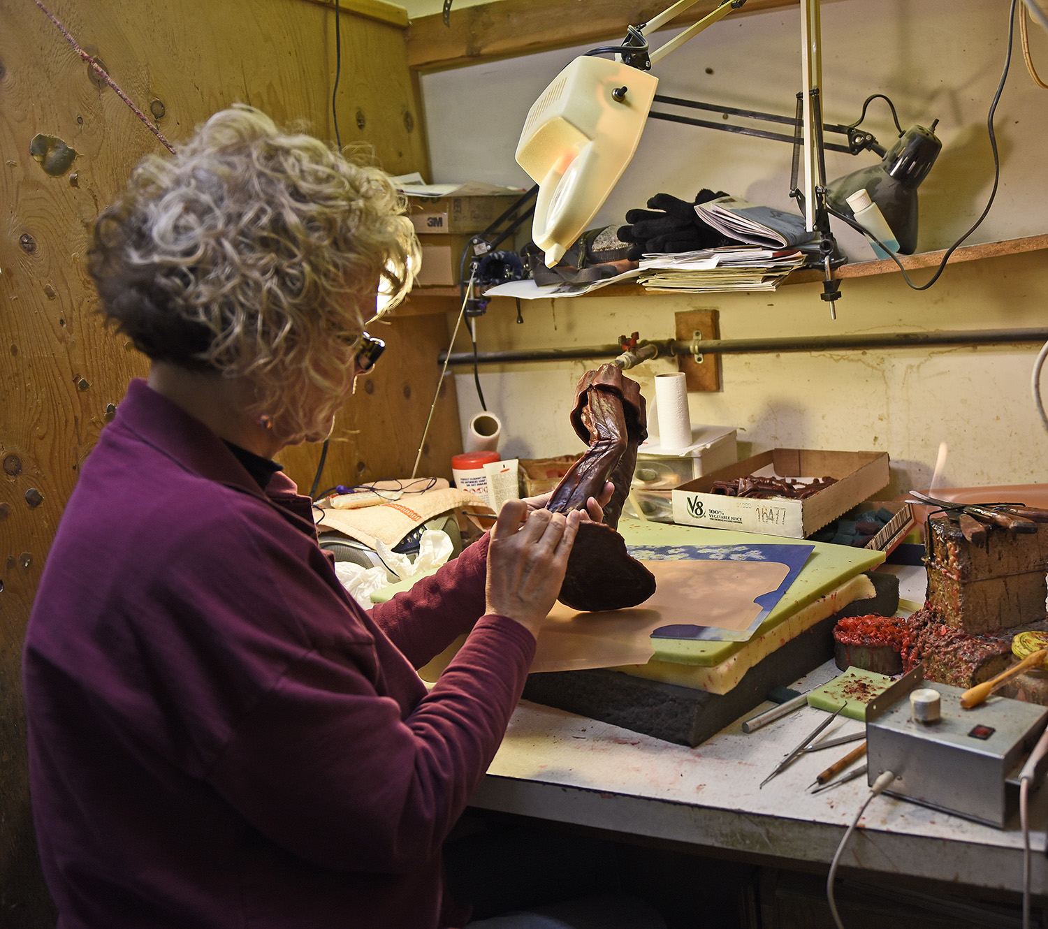 """Delicate work:  - A highly detailed stage with Sharon demonstrating """"chasing wax"""". All the imperfections from the previous stage are meticulously removed and any missing details painstakingly restored to the artist's original clay."""
