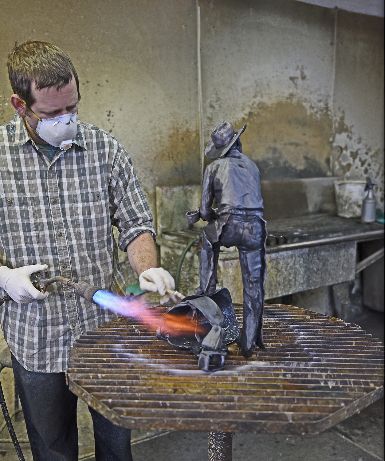"""Colour at last: - The last stage is where the final finish, or """"patina"""", is applied by burning pigment into the surface of the bronze. Here is where colour and shading can be applied. It is the last stage before the finished bronze is mounted onto a base."""