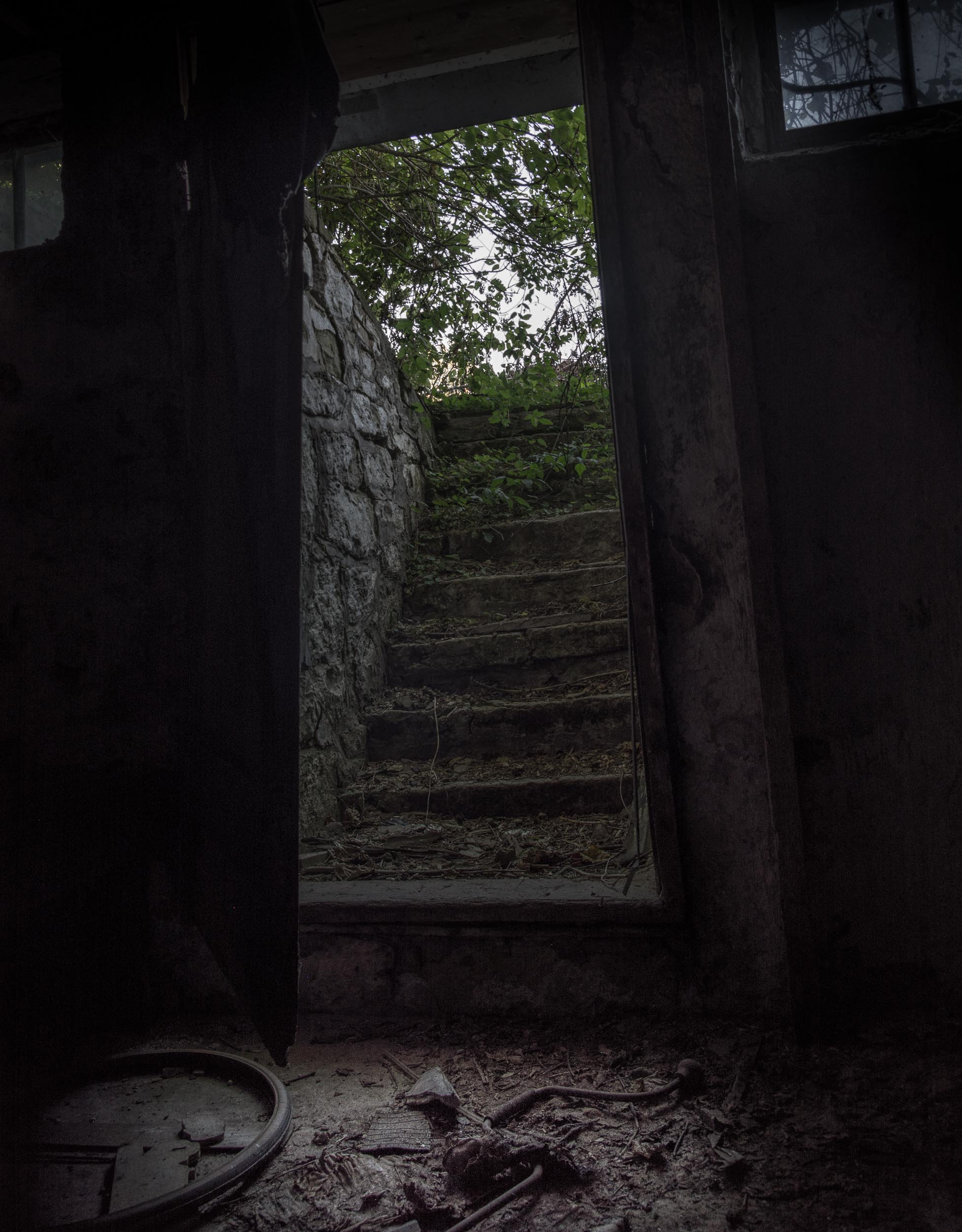 Scary basement of abandoned home | Stone staircase | Photo by BillyBengtson.com