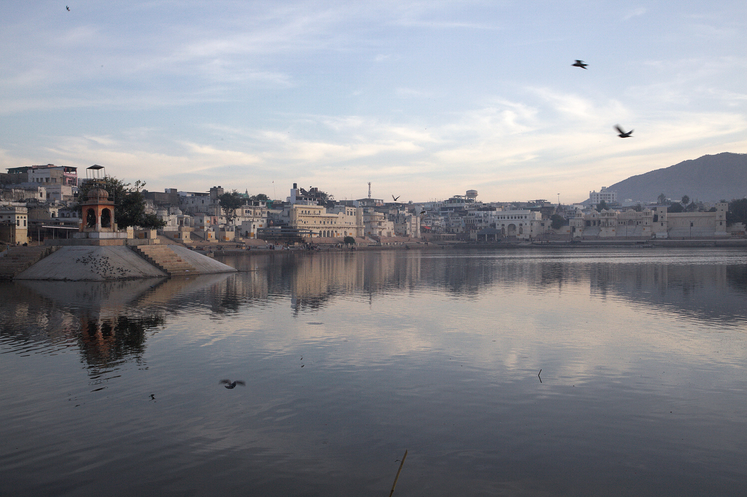 Pushkar Lake in Rajasthan. It was created when Brahma slew a demon with a lotus flower. Where the lotus petals fell three lakes appeared and Pushkar is the largest.