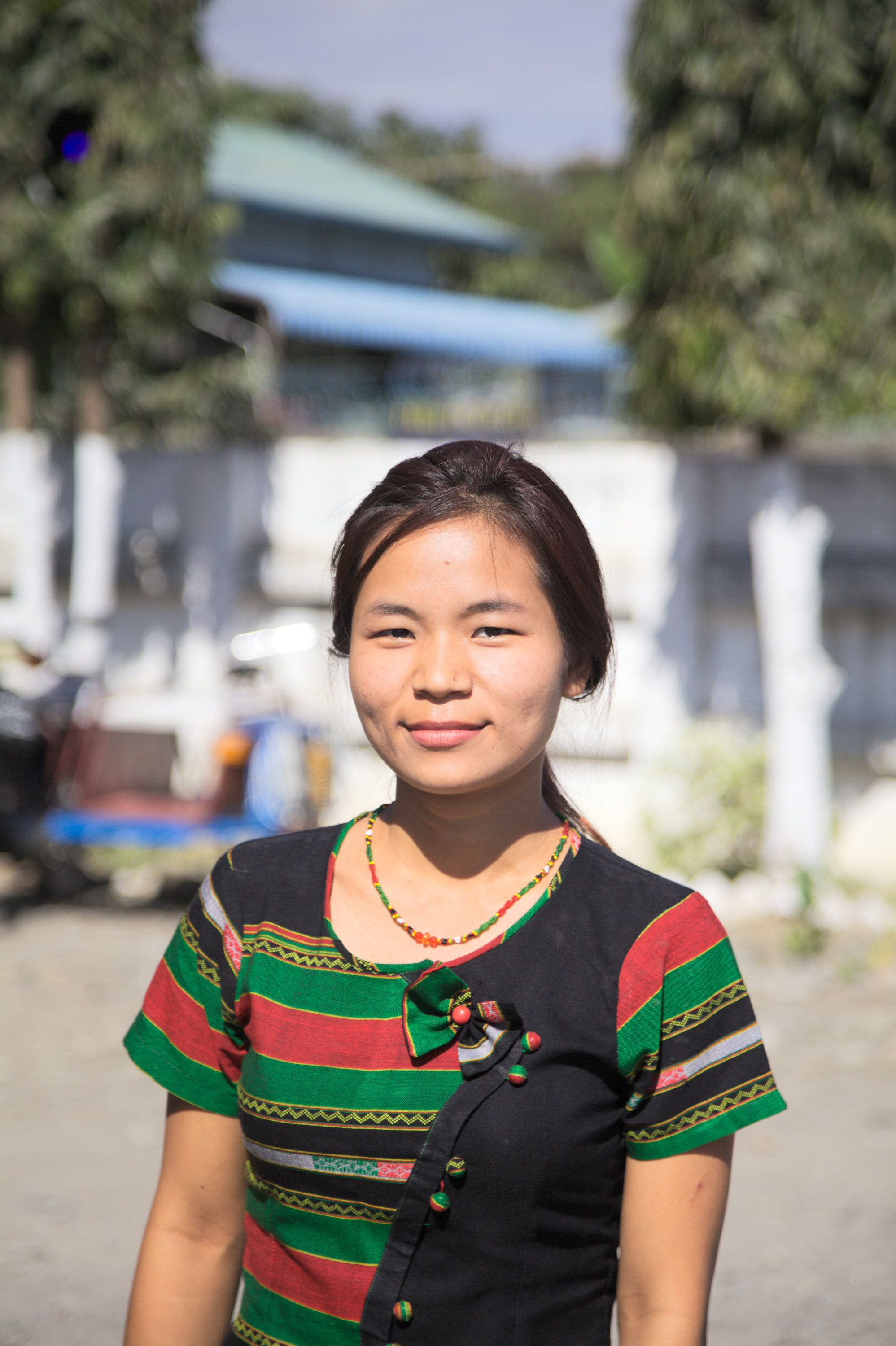 Worshipper in Zomi traditional colours, Kalaymo, Sagaing Division