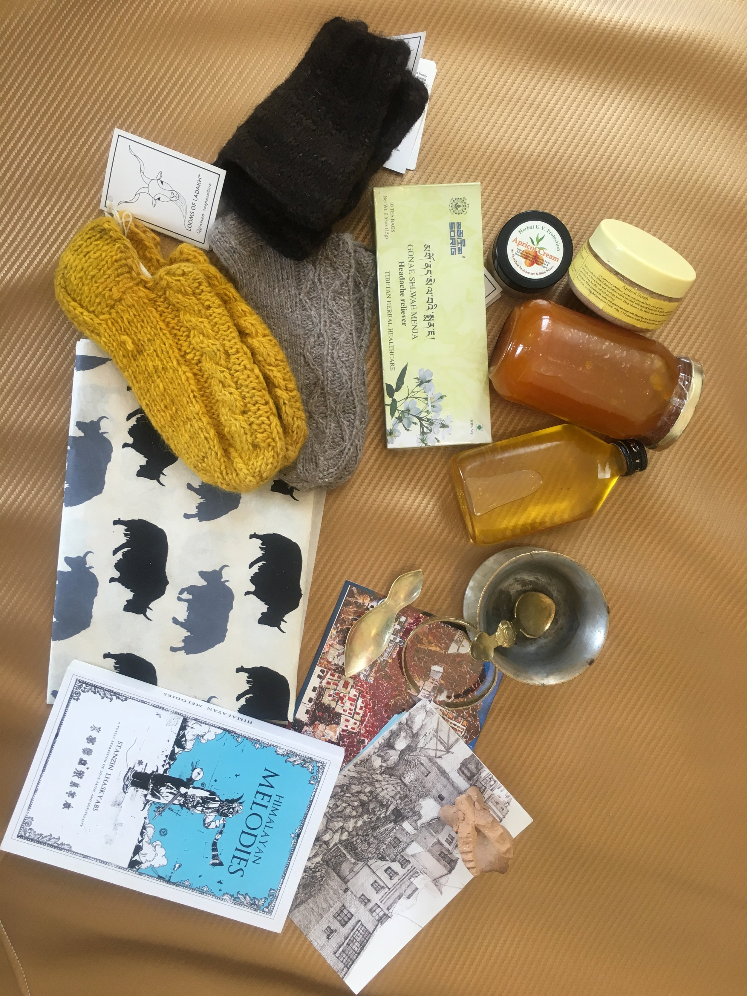 pashmina socks from looms of ladakhapricot scrub, jam, balm and oil from the apricot shopvintage cha cup from karmaPostcards from LAMO SHOPRICE ART PAPER FROM NORBULINKAPOETRY BOOKS FROM GULSHAN BOOKSHOP - what to buy in lEH?