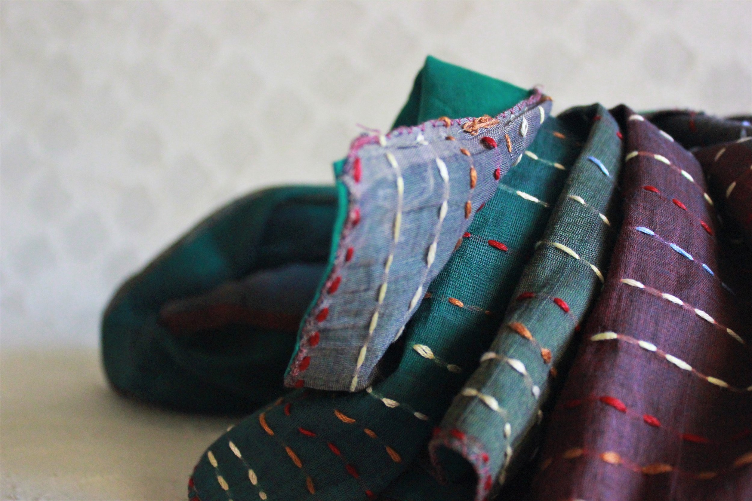 Accidentally burnt sari scrap -- multi-colour kantha threadwork.JPG