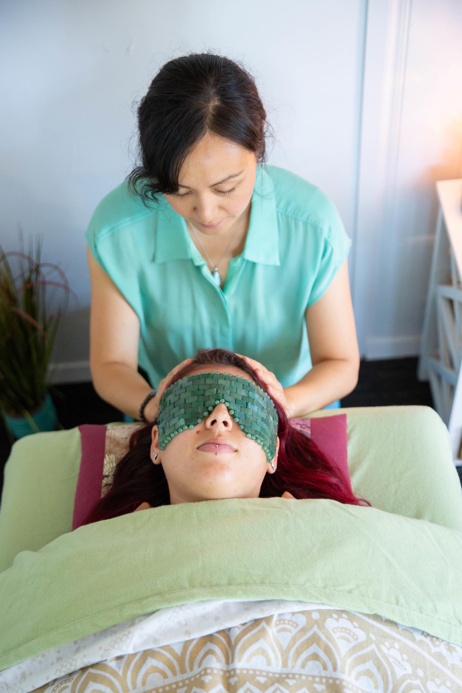 Client with Revital-Eyes in Green Aventurine  (Photo:    Keri Vaca   )