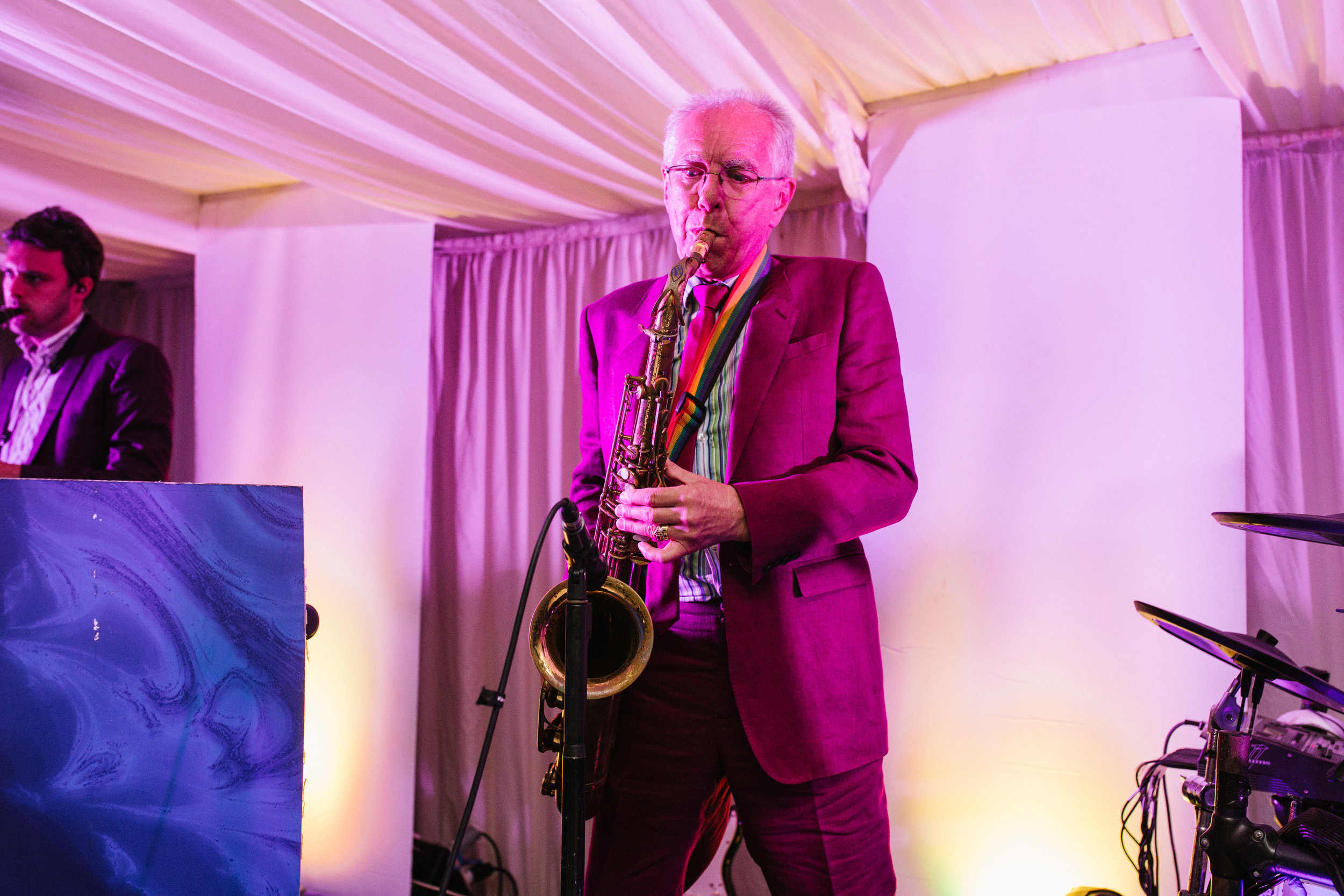 Nigel Tully MBE playing saxophone for the Dark Blues