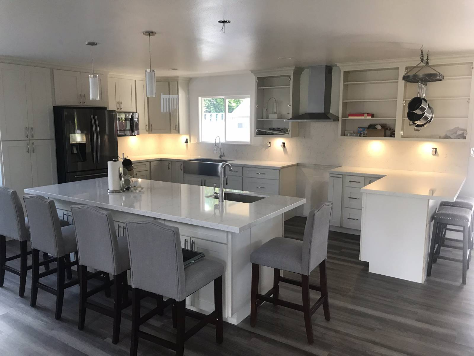 Mililani Residence - Island and kitchen counter tops with bar stool overhang and full-height back splash.