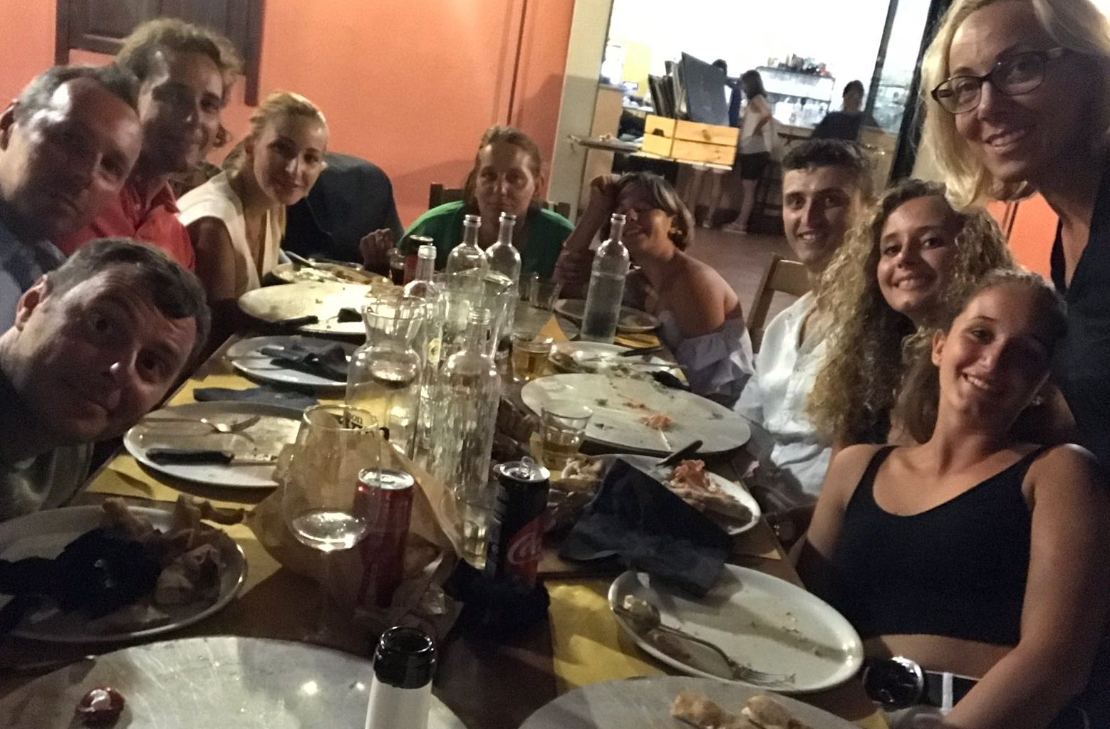 OUR EXTENDED FAMILY ENJOYING PANIGACCI, TESTAROLI AND FARINATA. A VERY CONVIVIAL WAY TO EAT! NOTE THEY ARE DRINKING MOSTLY WATER :)