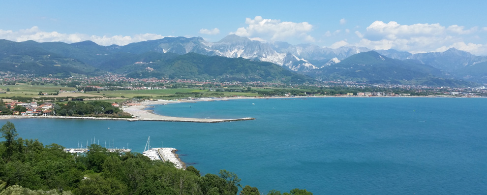 THE MARBLE QUARRIES OF CARRARA ACROSS THE SOUND OF THE MAGRA RIVER LOOK LIKE SNOW EVEN IN SUMMER