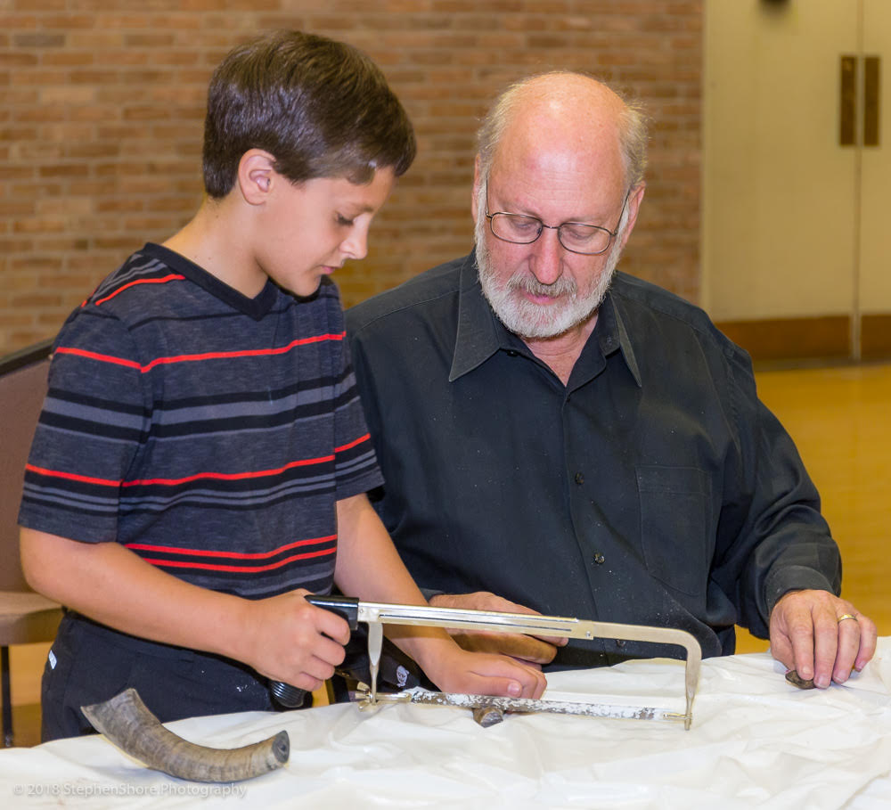 ANNUAL SHOFAR FACTORY    Each school year the Brotherhood's annual Shofar Factory provides material, tools, and instruction to the Fifth Graders in the Temple's religious school so that each student can make and have their own personal shofar.