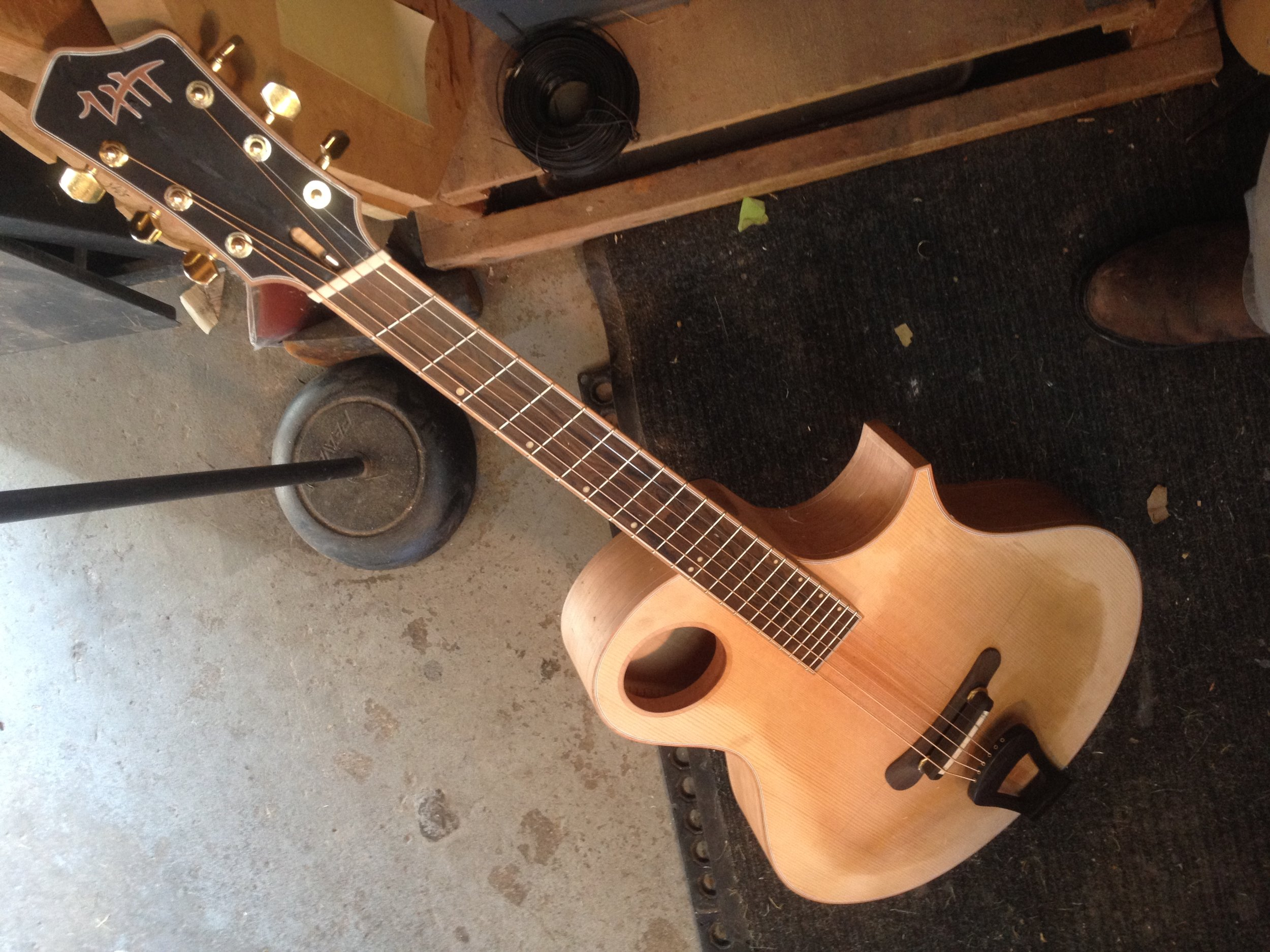 Shown in the white (no finish) with strings on for voicing