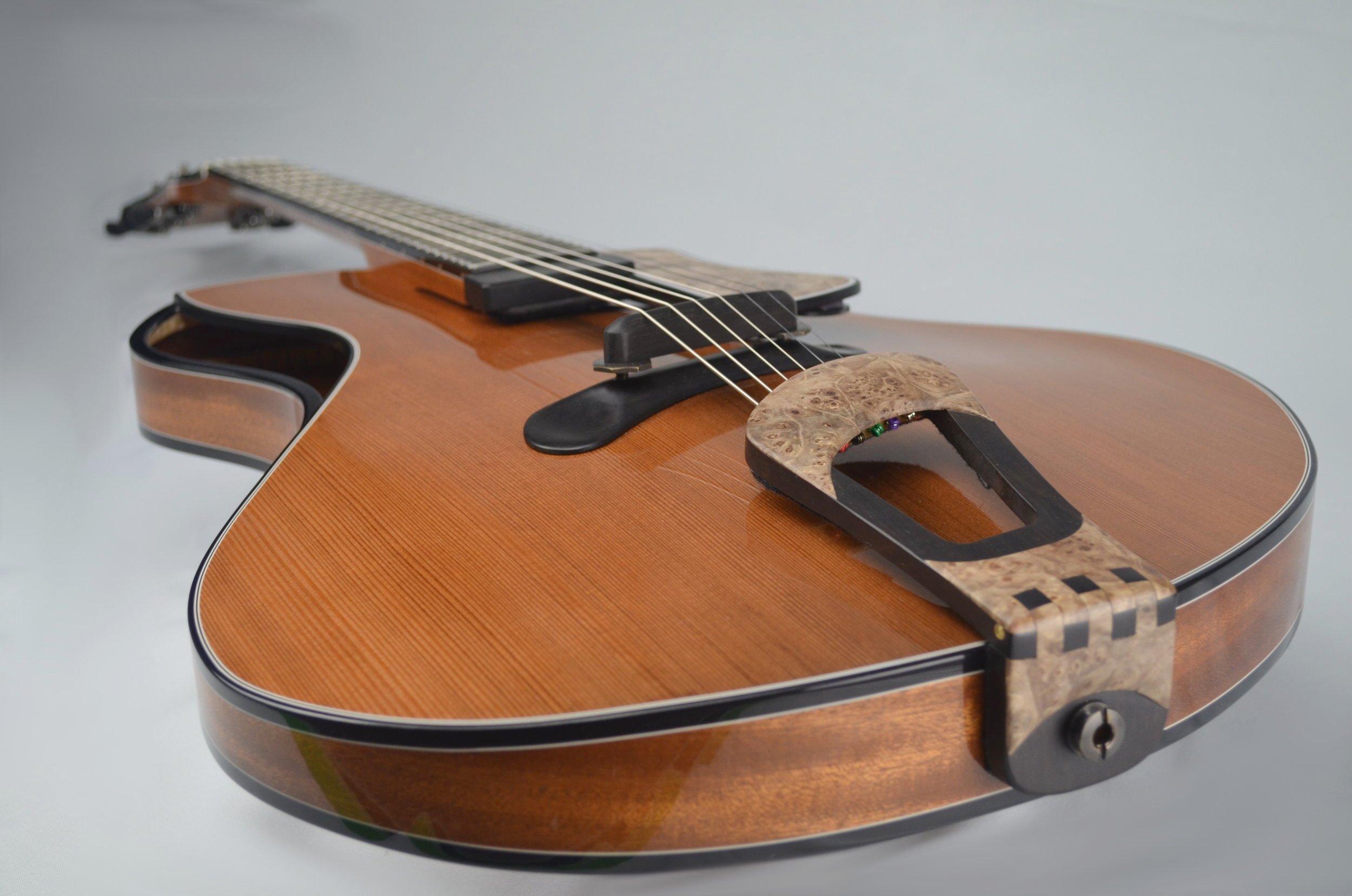 Redwood and Sapele thinline displays the flowing lines of the arm bevel and soundhole