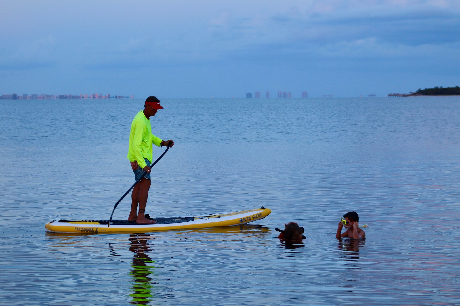 Dr. Bruce Neill supervises snorkelers via stand up paddleboard in San Carlos Bay.