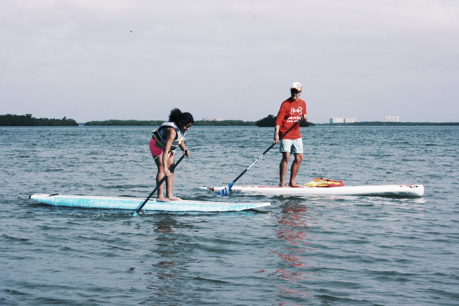 Johnny Rader teaches a stand up paddleboarding lesson on San Carlos Bay.