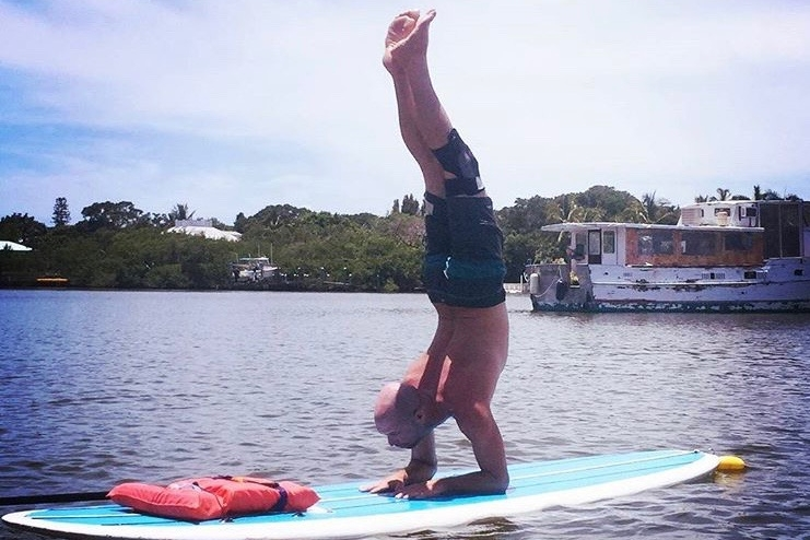 John Houston combines his love of yoga and paddle sports.