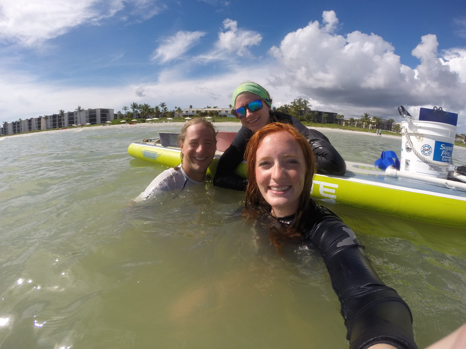 Sanibel Sea School's sand dollar research team uses a stand up paddleboard to transport their gear.