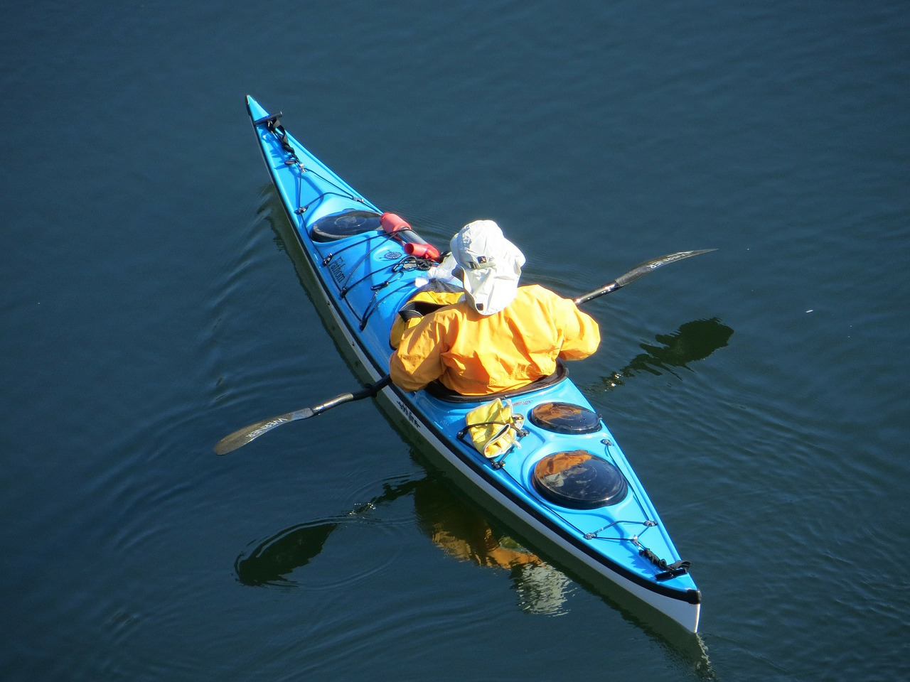Insulation and protection from wind and water are important factors to consider when choosing your paddling outfit.