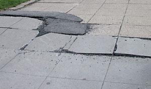 sidewalk-broken-pavement.jpg