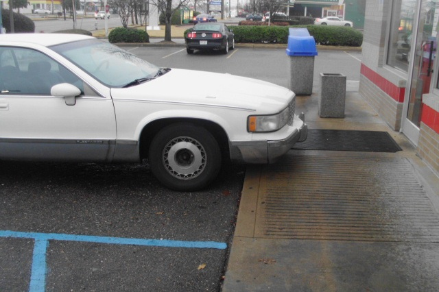 Car parked incorrectly in handicapped parking space