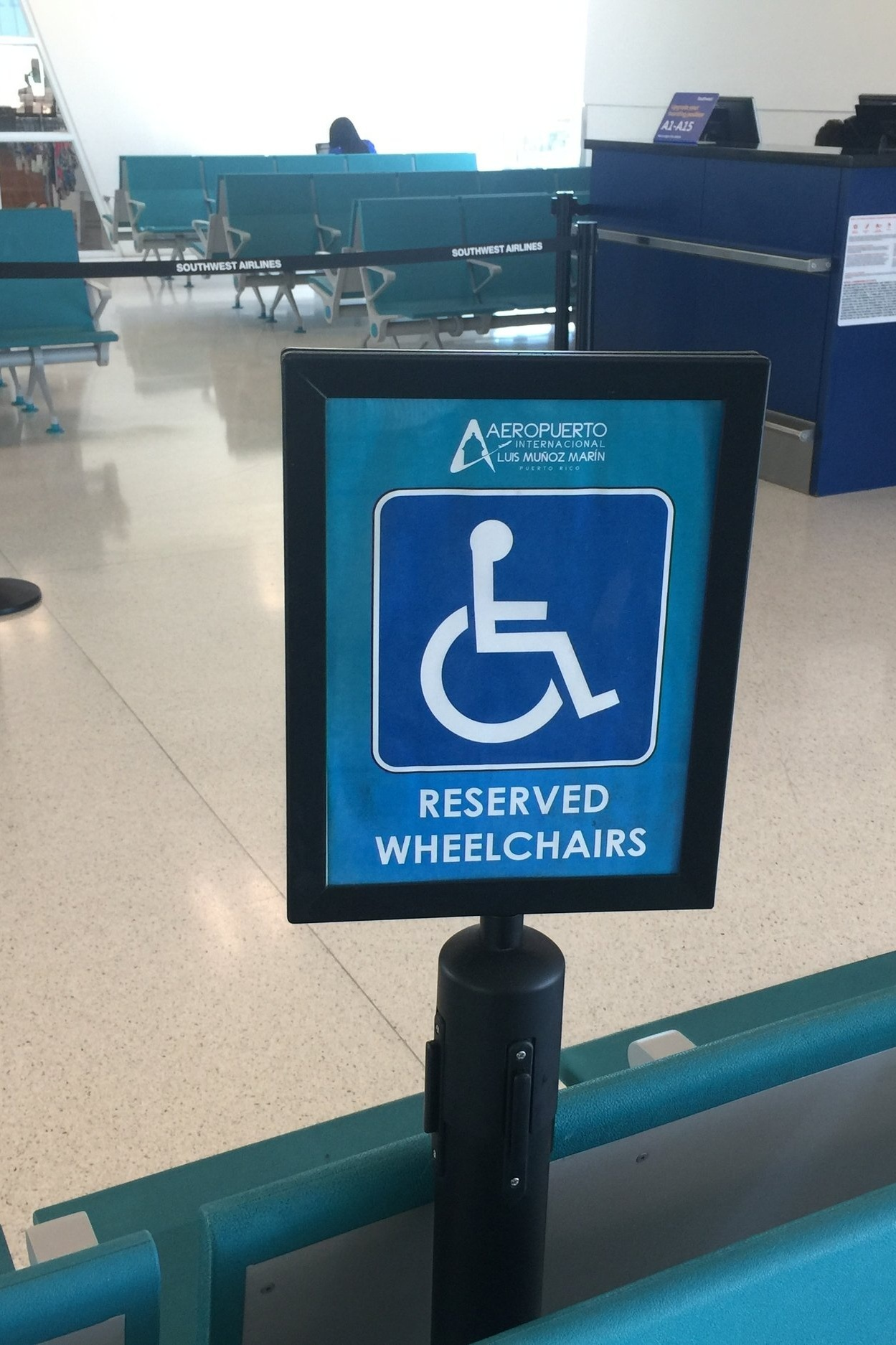 Airport%2BDisabled%2BSeating%2BSign%2BCloseup.jpg