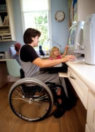 Person in Wheel Chair at Desk