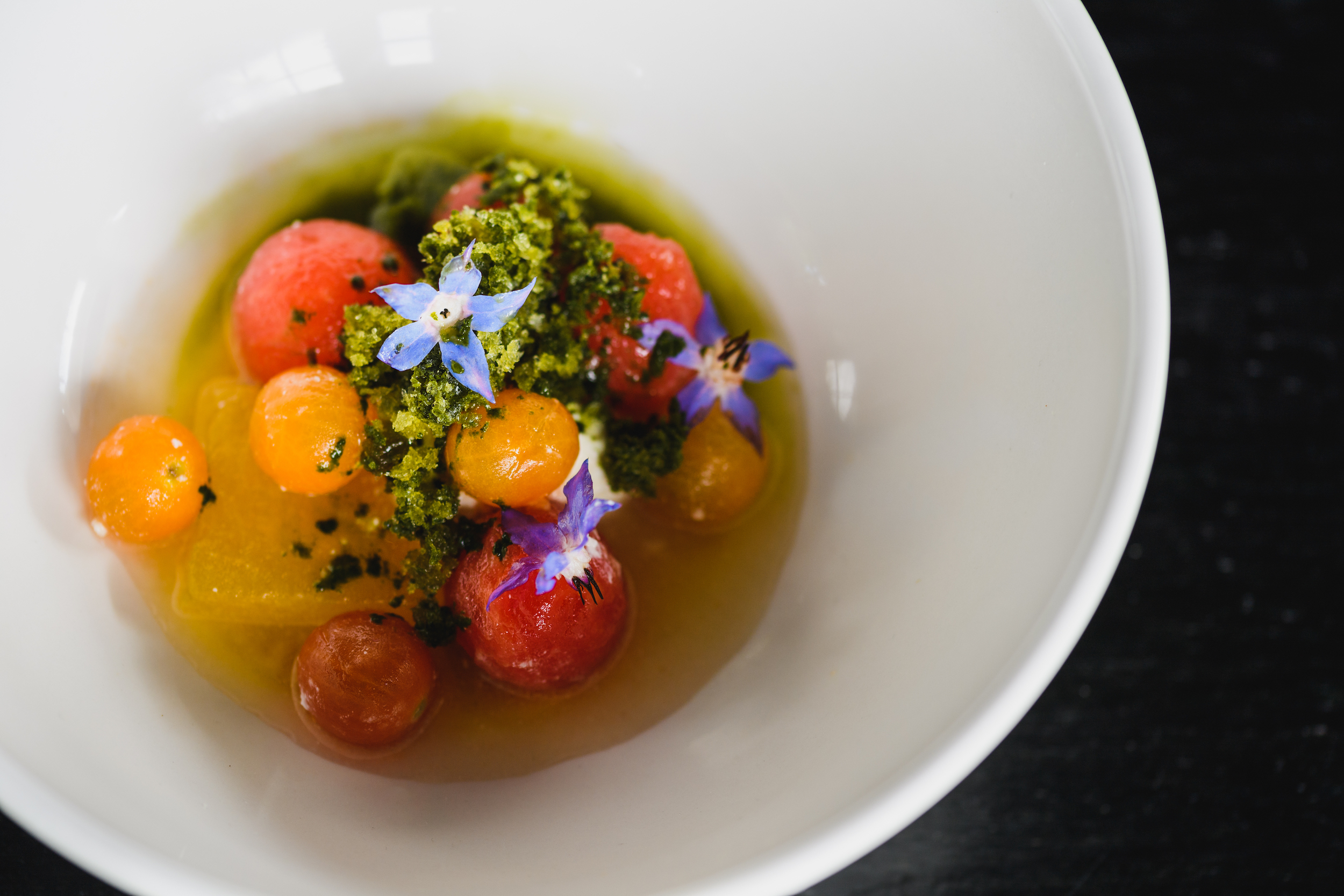 The Garden concase garden tomato, whey compressed watermelon, walnut oil dehydrated watermelon, fresh watermelon, tomato and whey consommé, borage  (1).jpg