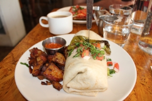 $10 breakfast burrito -- scrambled eggs, roasted peppers, mushrooms, sweet onions & chihuahua cheese in a flour tortilla. Plated with housemate hot sauce and ancho chili sauce on top. $3 breakfast potatoes on the side (because let's be real, it's never a complete brunch without some amazing breakfast potatoes!)