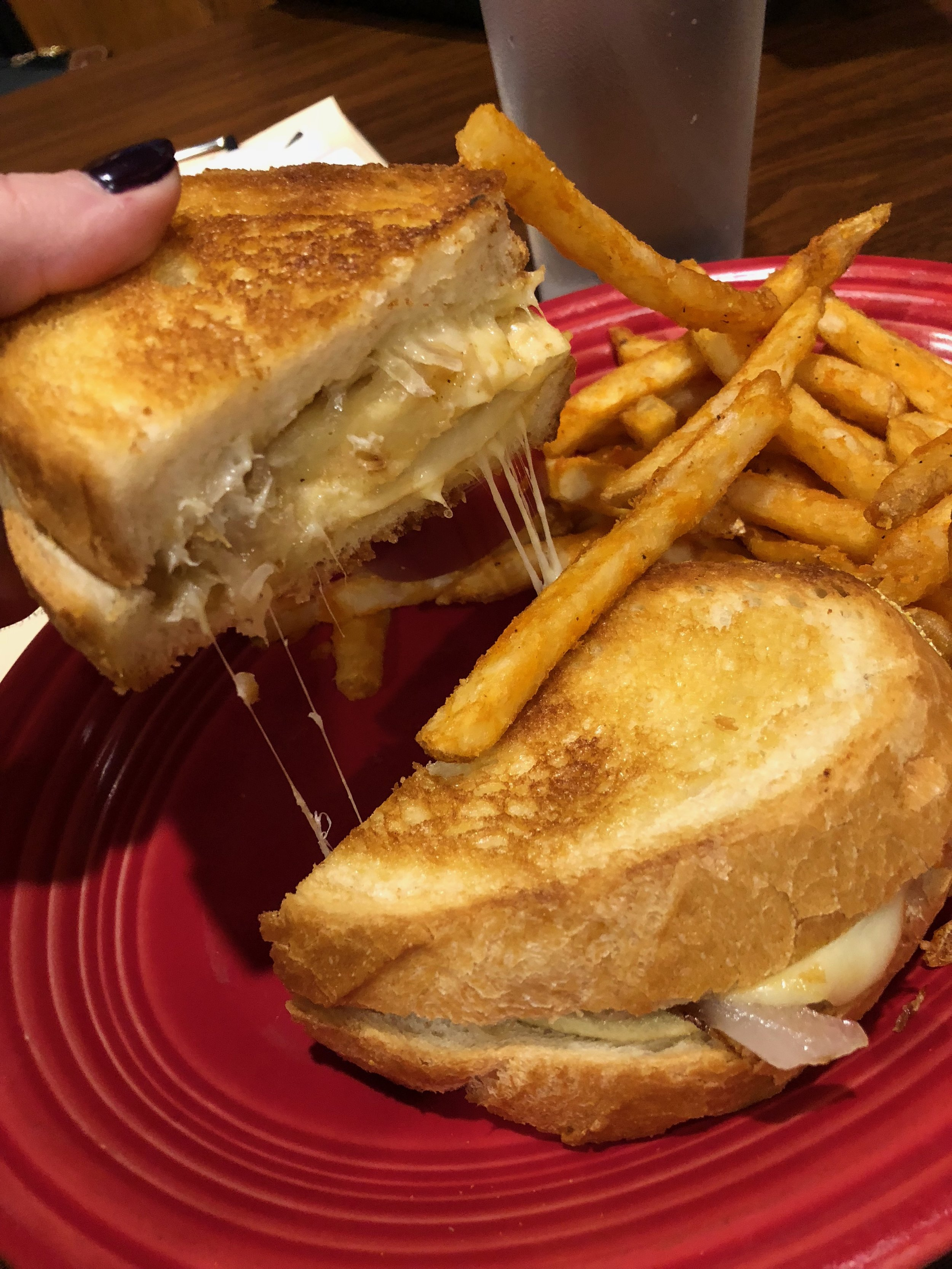 Pittsburgh Grilled Cheese - A grilled cheese sandwich with melted Muenster, pierogies, sauerkraut and onions on buttered Italian bread