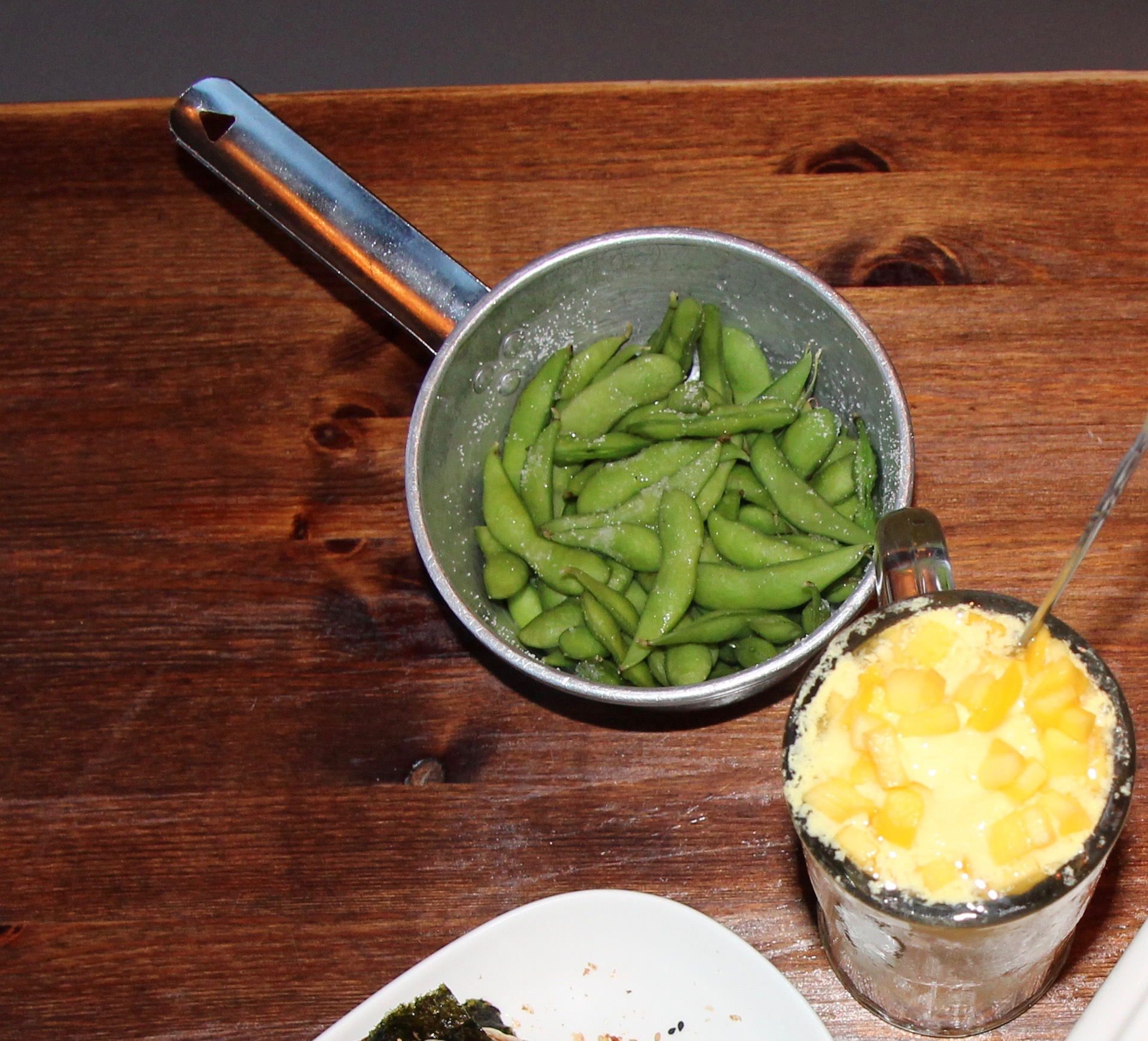 Salted Edamame (with the very mango milkshake to the right)
