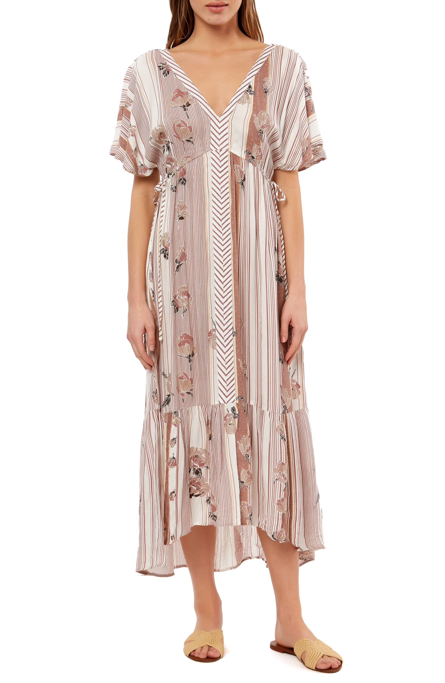 This runs BIG and is a deep V, which makes it great for a coverup or casual beach dress!