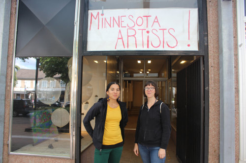 Lela Pierce & Sarita Zaleha pictured next to artwork by Zaleha