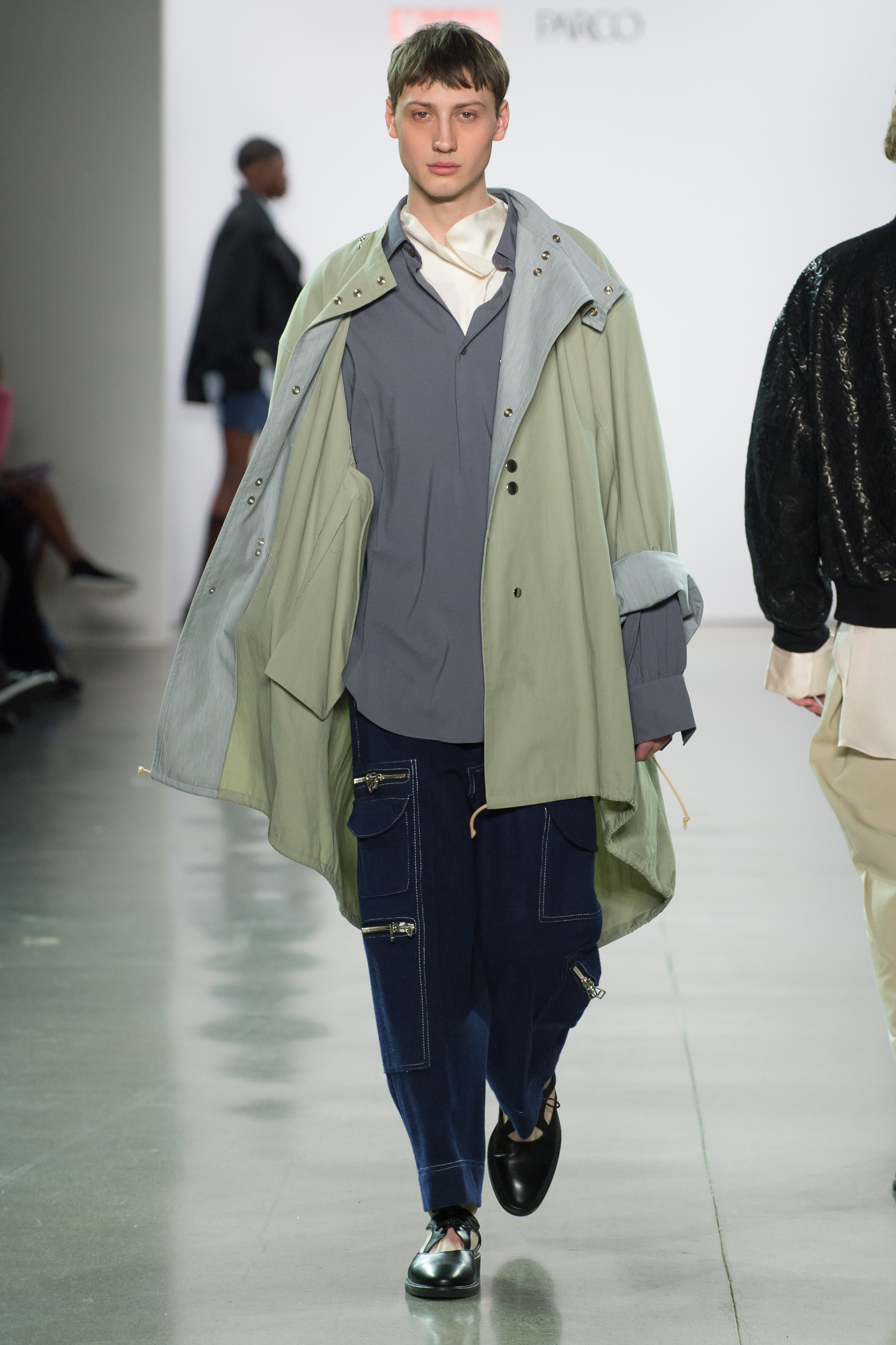 Look 4  -Tent parka in dusty grass cotton canvas  -Big polo in ice gray double face heavy georgette  -Fold collar top in cream silk twill  -Utility pants in navy wool melton