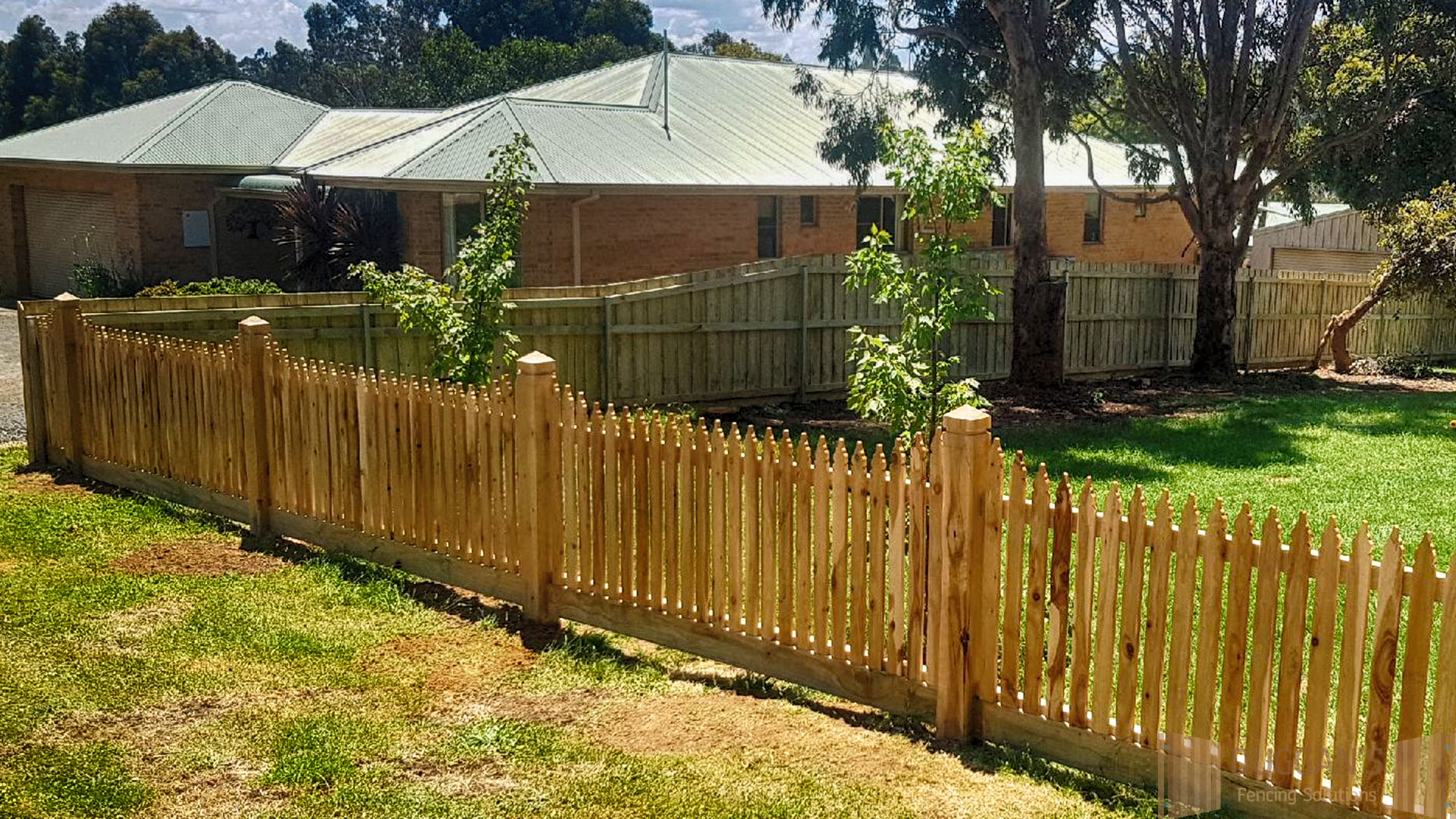 Picket front fence and a Timber side fence
