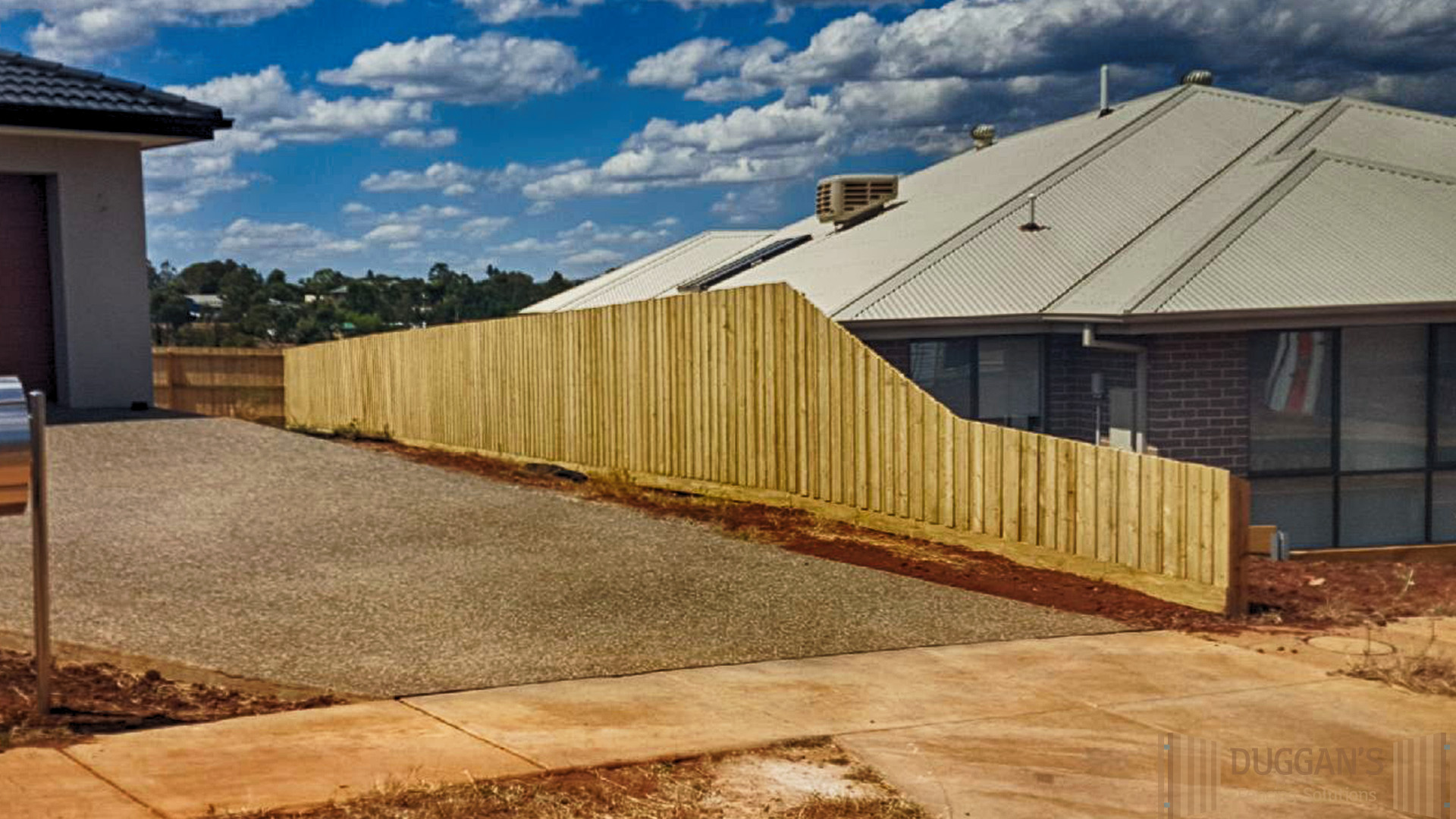 Mixed height Timber Fence