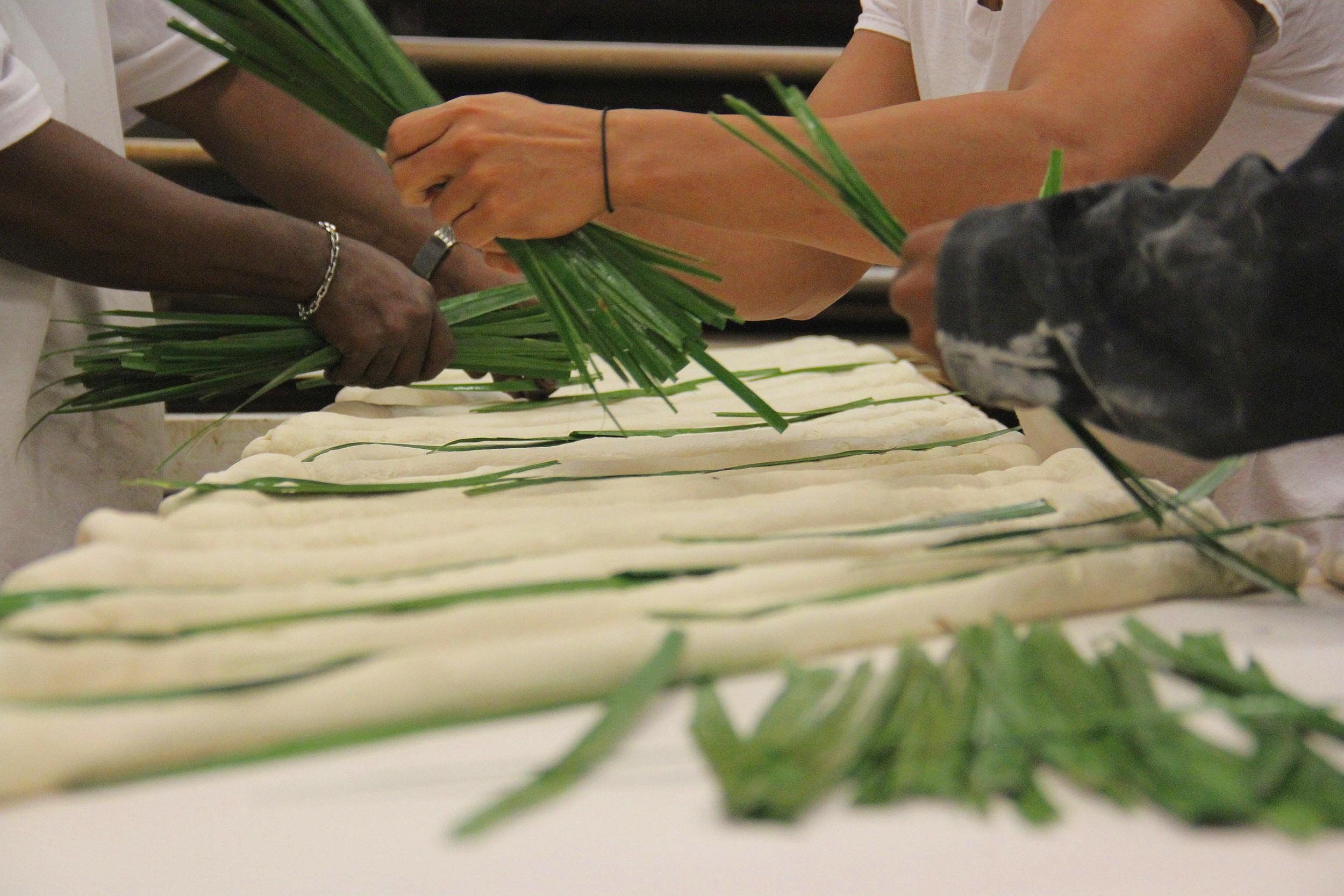 Palmetto leaf is placed on the bread in La Segunda Bakery