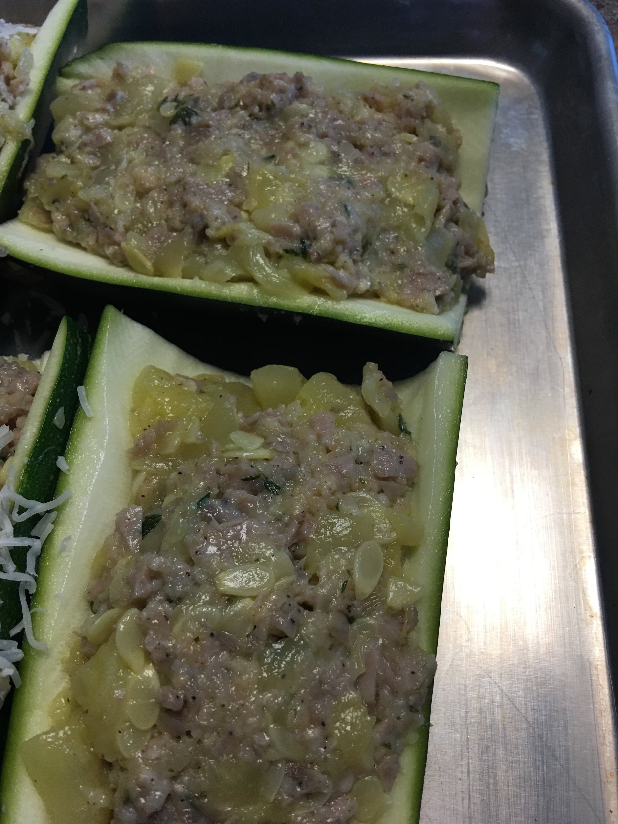 Looking for zucchini recipes? Try this healthy stuffed zucchini recipe: Leigh's Clean and Delicious Stuffed Zucchini!