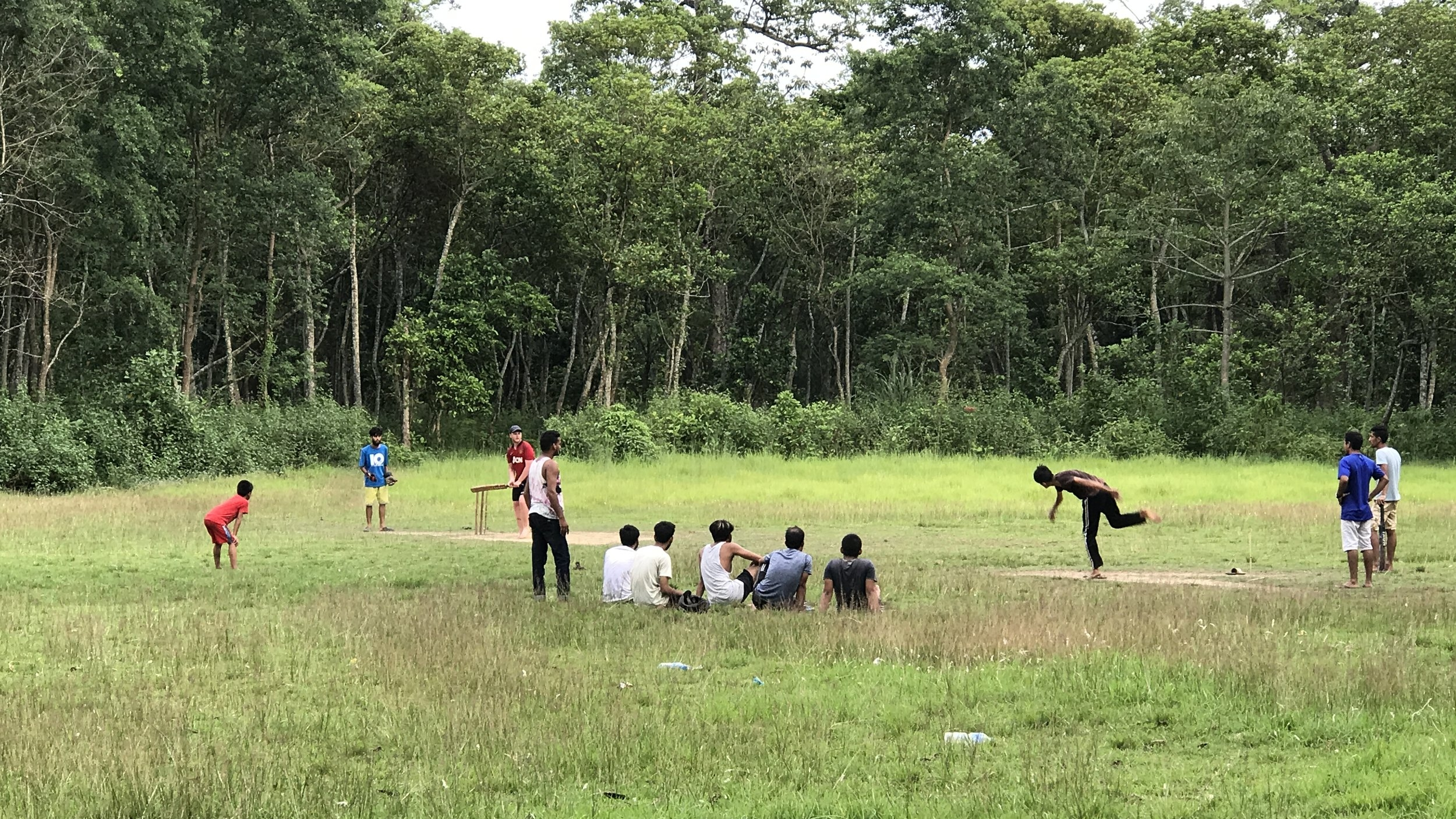 a session of backyard cricket in the sauraha rainforest with the local kids