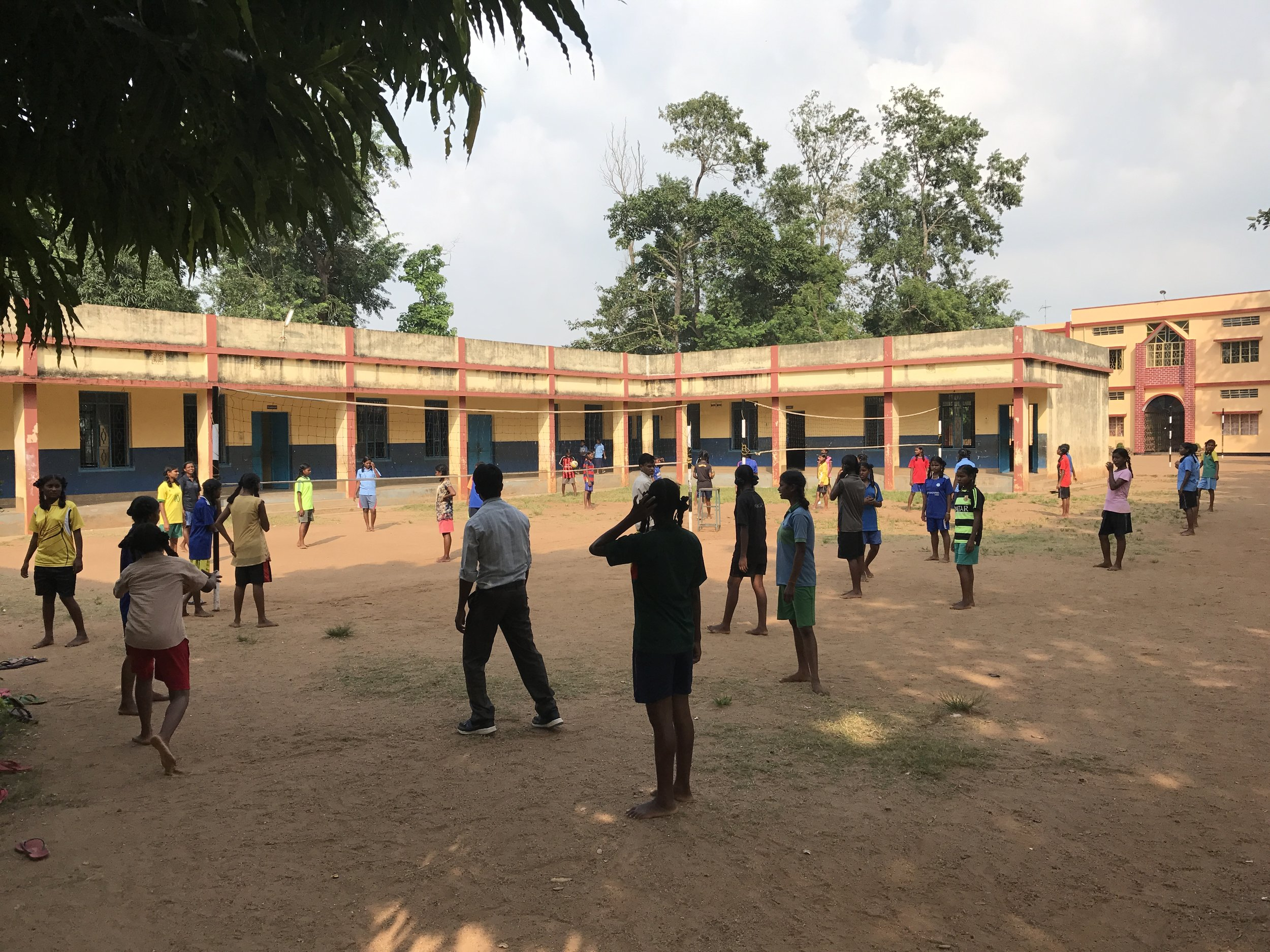 a game of volleyball at the primary school bernard established and taught at for roughly 60 years