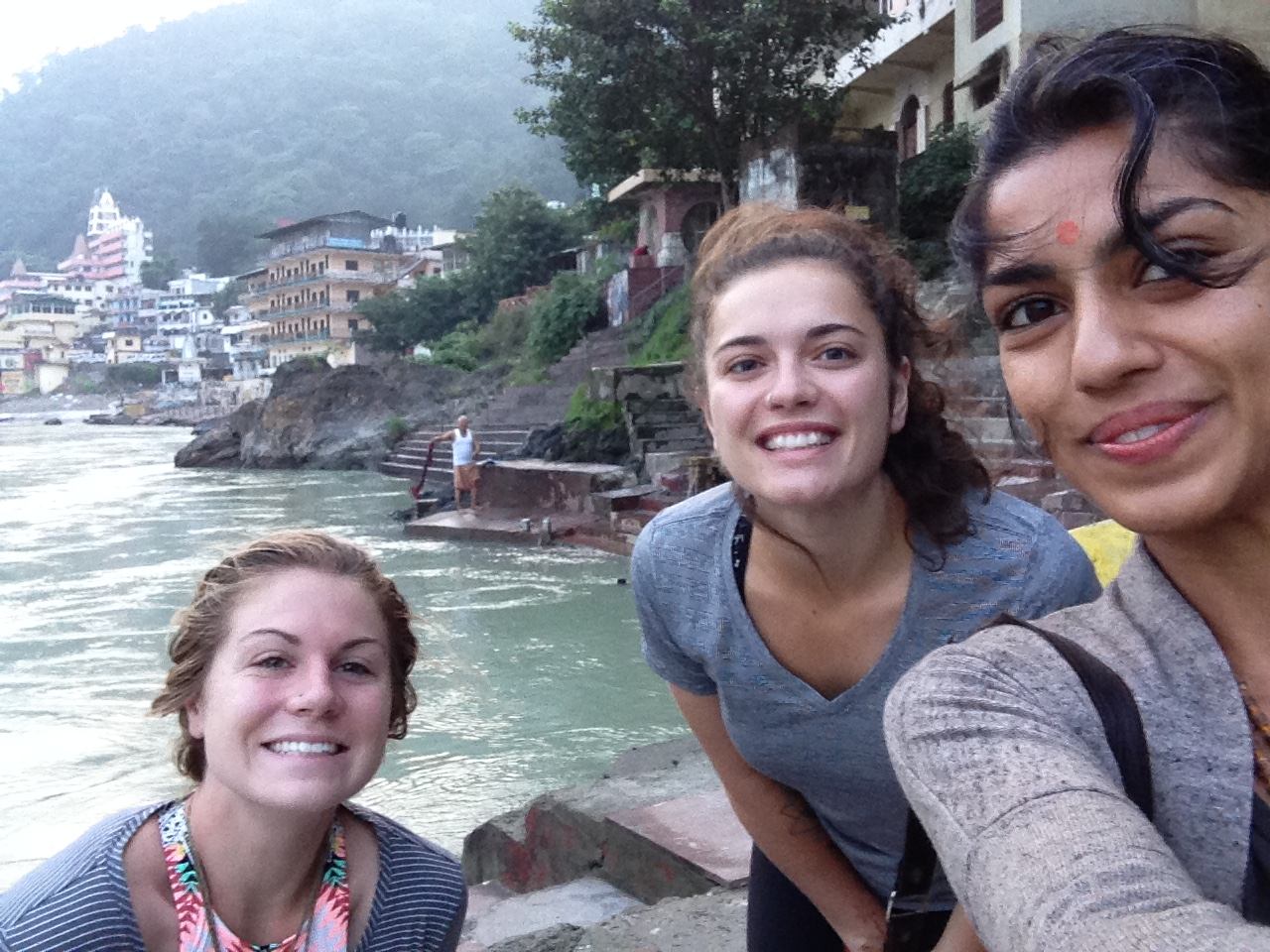 kim (who was in the other stream of the august intake), myself and jal down at the river ganga at sunrise for an early morning dip - wE hadn't plunged in at this point, whch is why we're looking a bit weary!