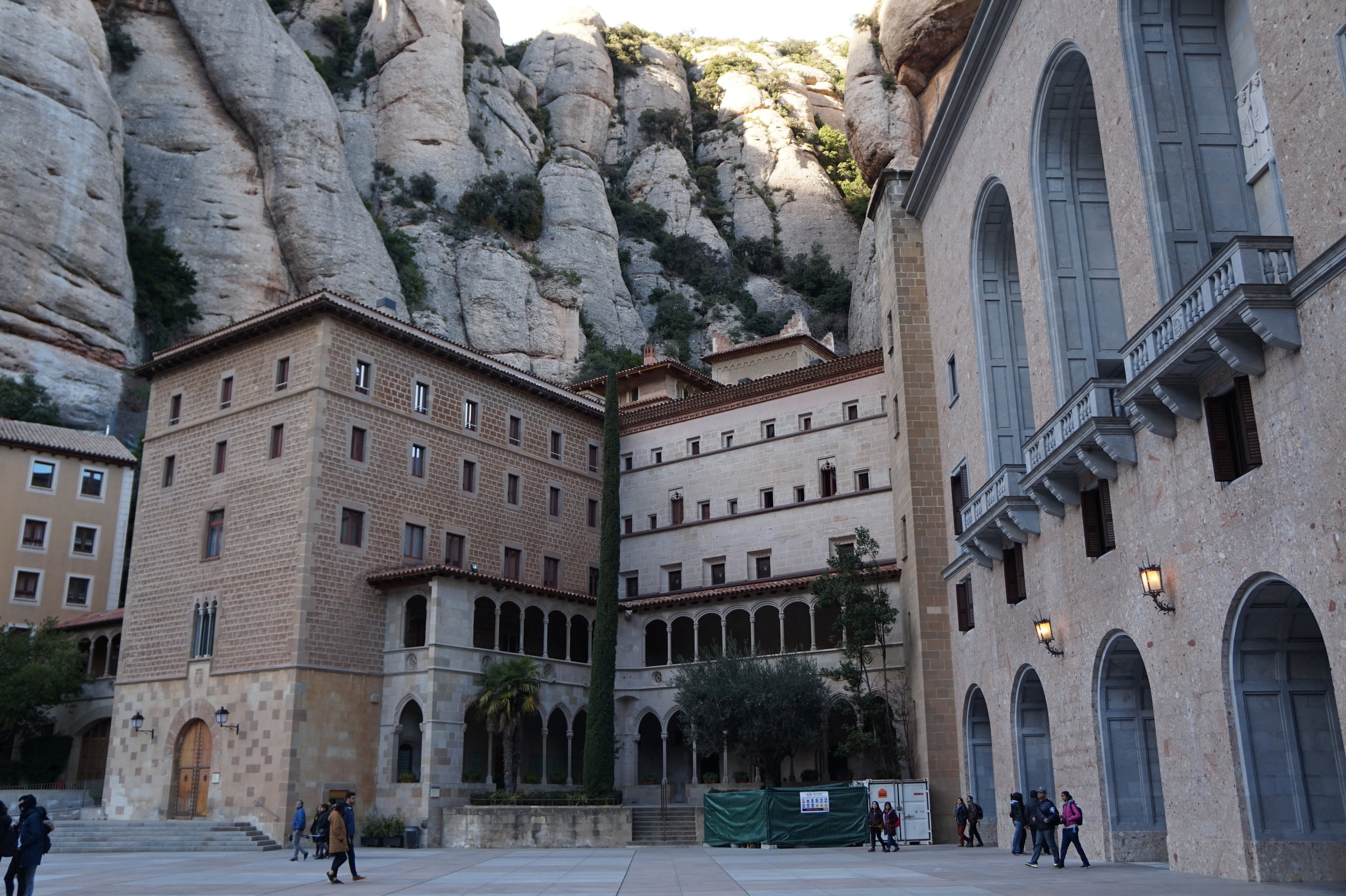 the entrance to the  Santa Maria de Montserrat  abbey - you can see the 'serrated' mountain formation in the background