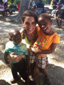 Brenda with children at a Consider Haiti medical clinic.