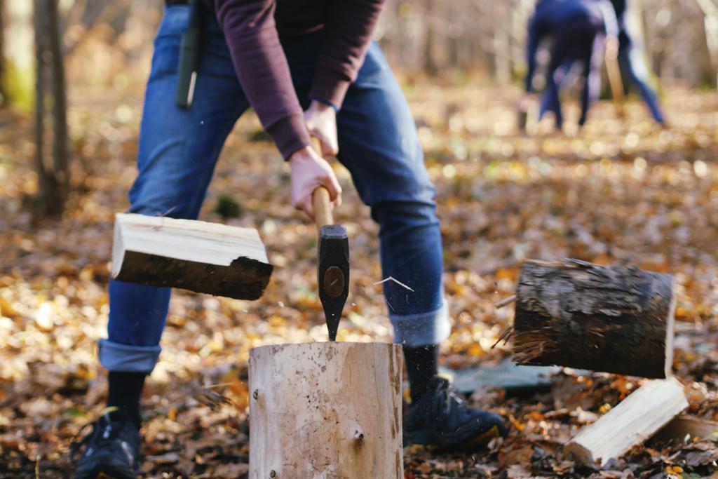 Splitting firewood with a maul.