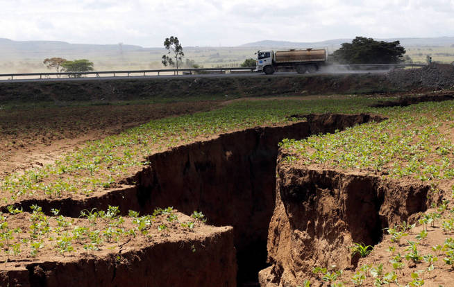 a-tanker-drives-near-a-chasm-suspected-to-have-been-caused-by-a-heavy-downpour-along-an-underground-fault-line-near-the-rift-valley-town-of-mai-mahiu-kenya-march-28-2018-picture-taken-march-28-2018-reuters-thomas.jpg